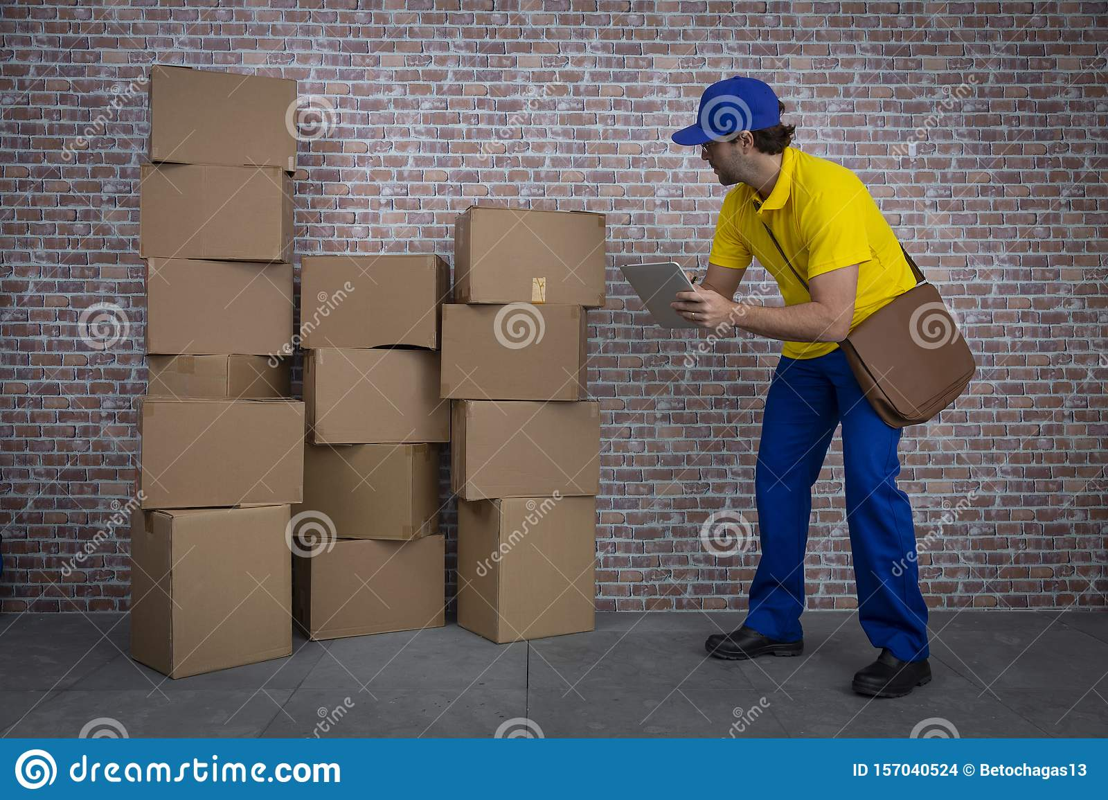 Brazilian mailman checking a lot of packages