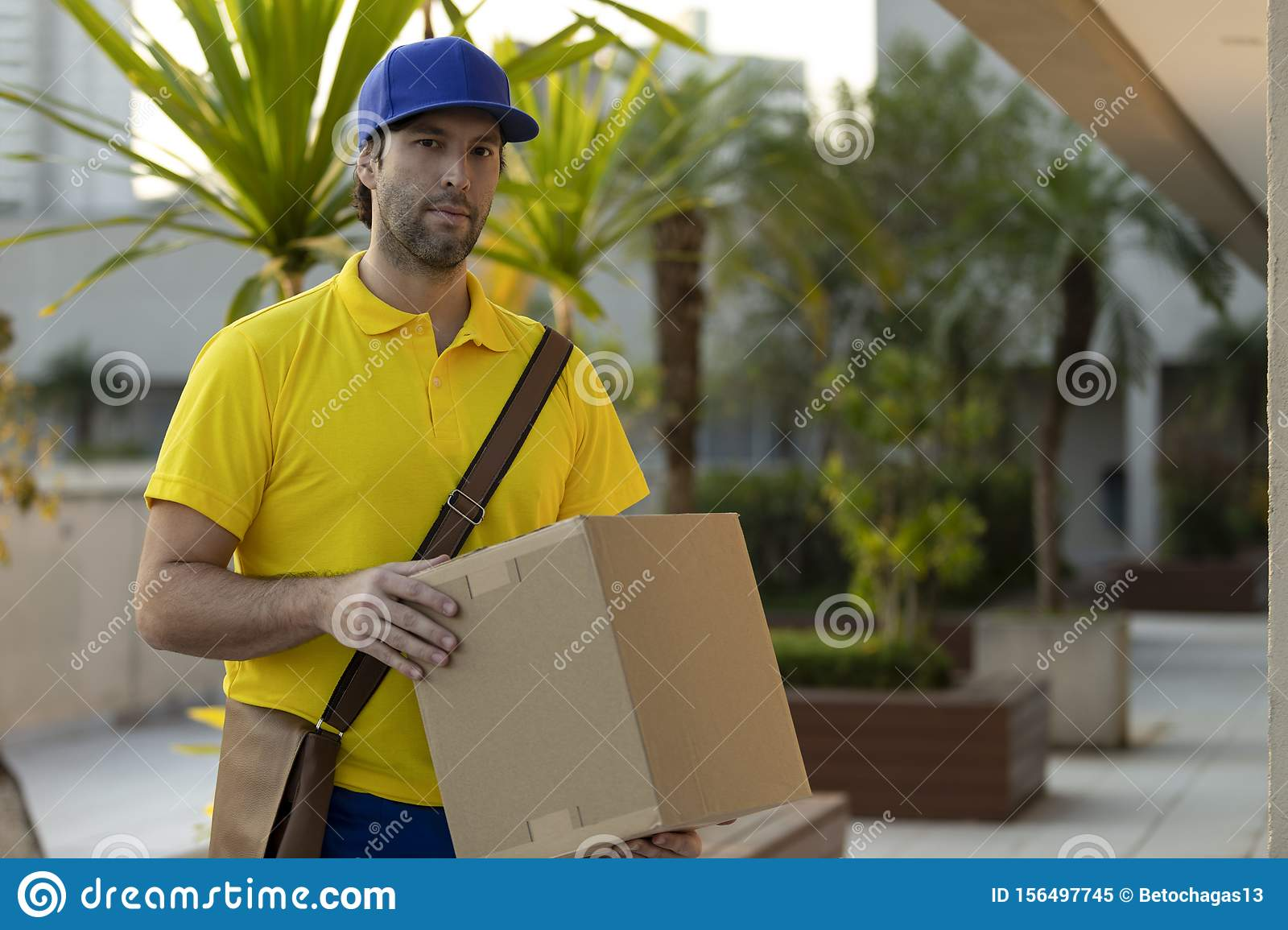Brazilian mailman delivering a package