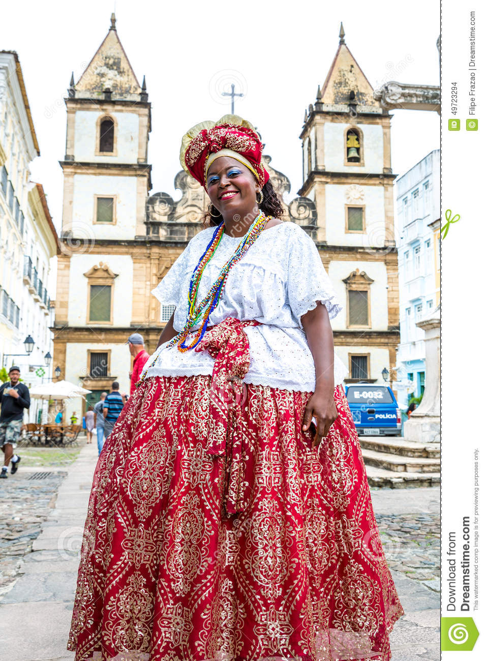 A Brazilian Woman Of African Descent, Smiling, Wearing ...