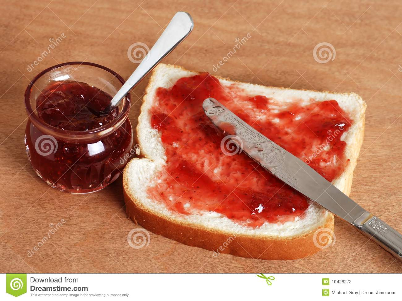 Kitchen table close up - Bread And Jam With Knife Stock Photos Image 10428273