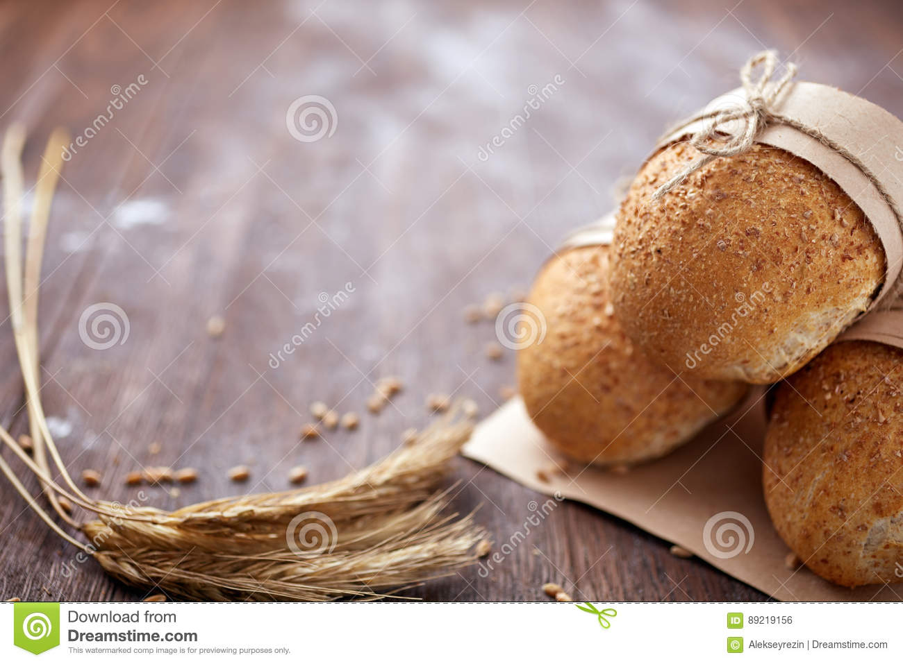 Bread loaf rustic selection of rye, soda, bloomer breads, with granary and oated rolls and ears of wheat.