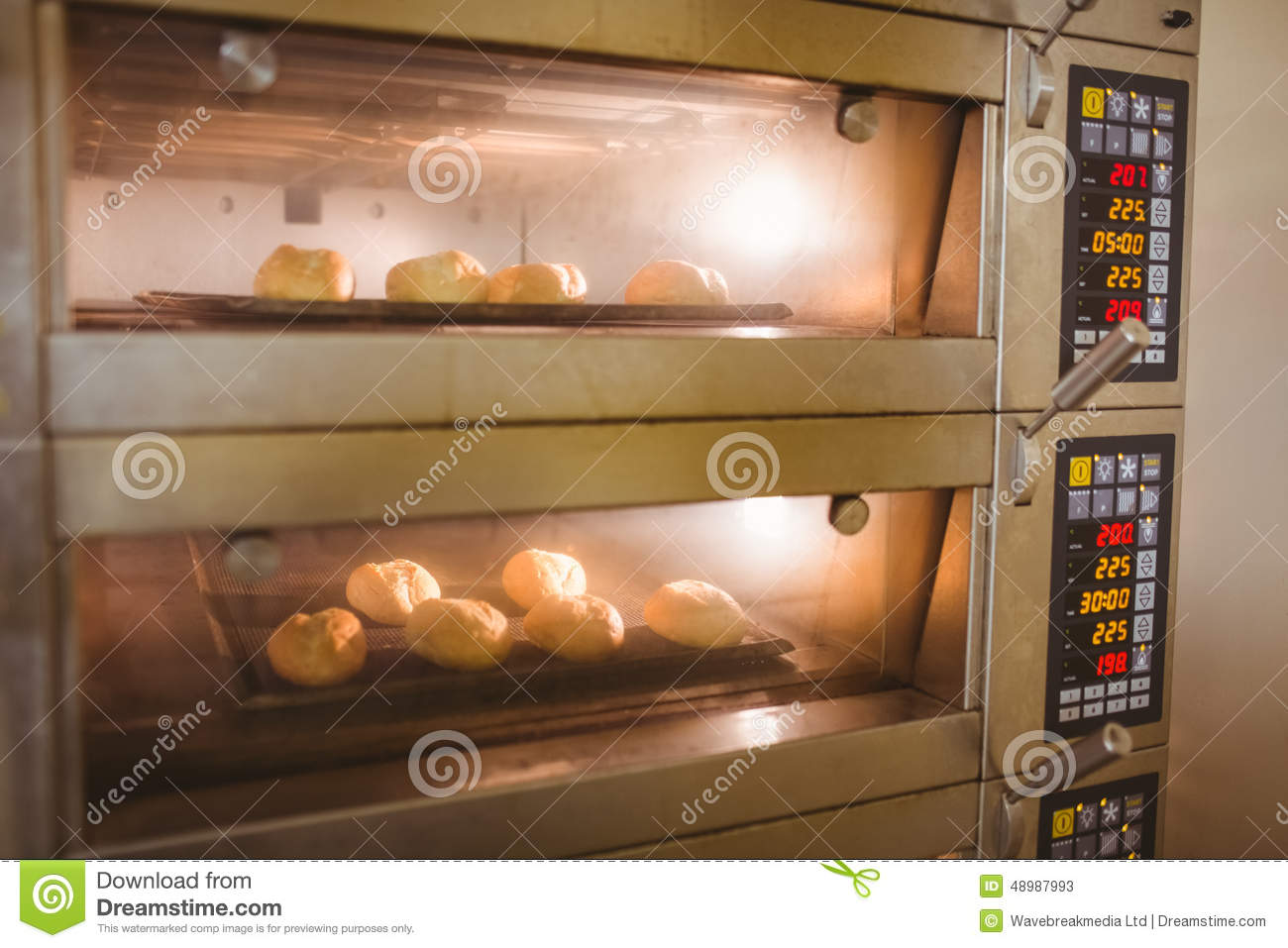 Bread rolls baking in oven stock image. Image of culinary ...
