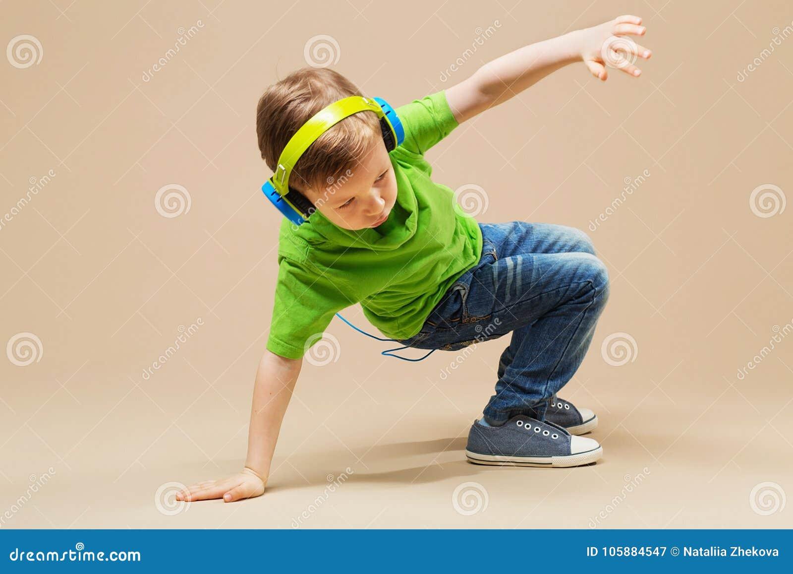 break dance kids. little break dancer showing his skills in dance studio. Hip hop dancer boy performing over studio background