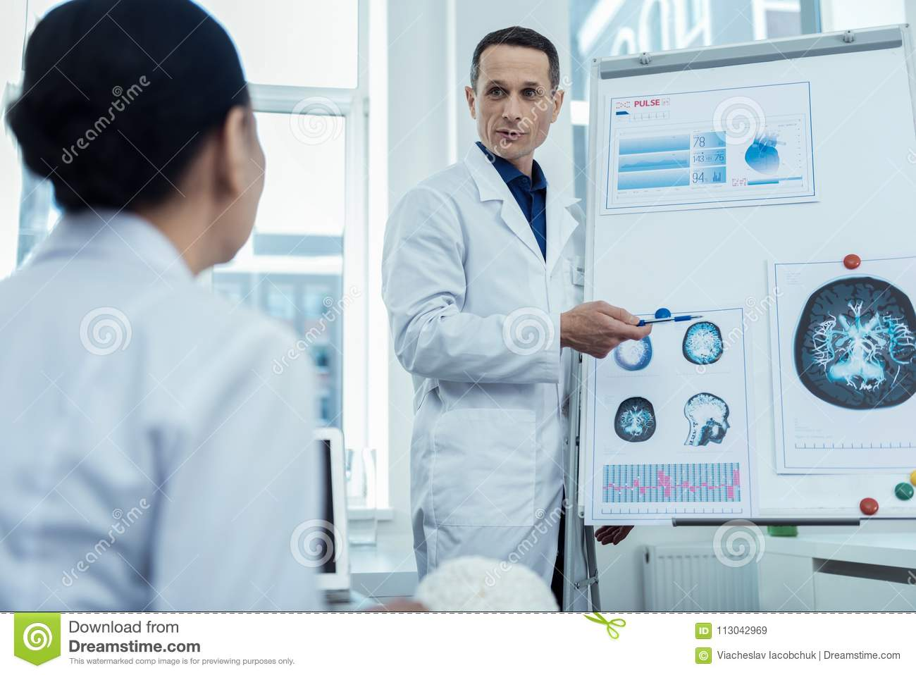 Professional Male Researcher Presenting His Research Stock
