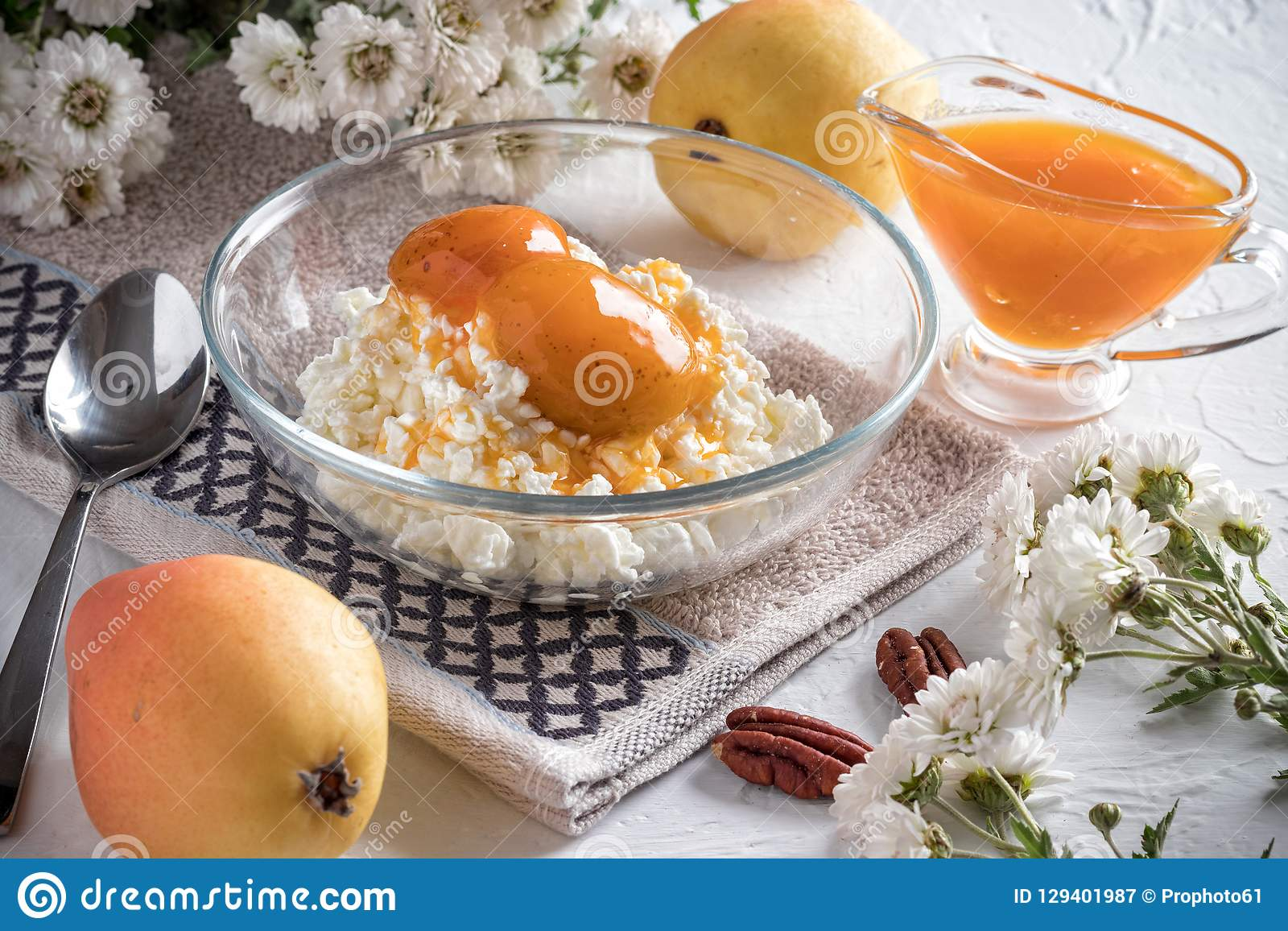 Breakfast of cottage cheese, pear and jam royalty free stock photography