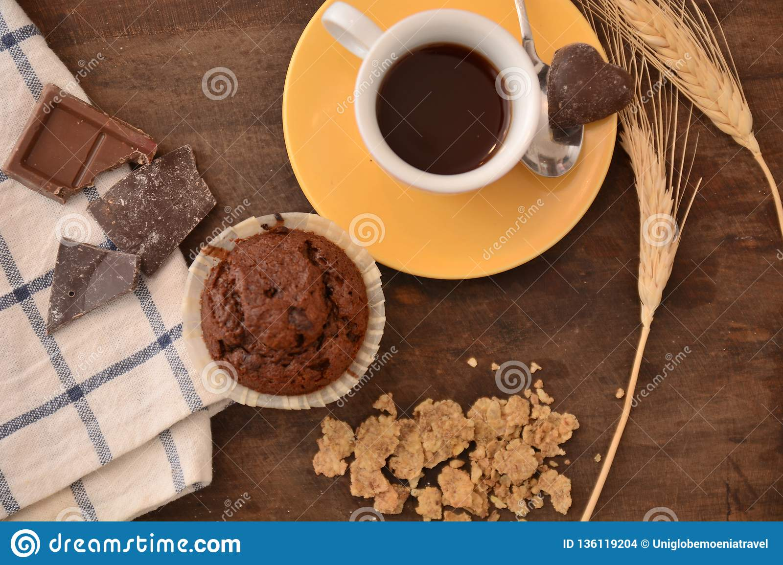 Breakfast cup coffe espresso black cereals muffin milk chocolate pieces on table morning food