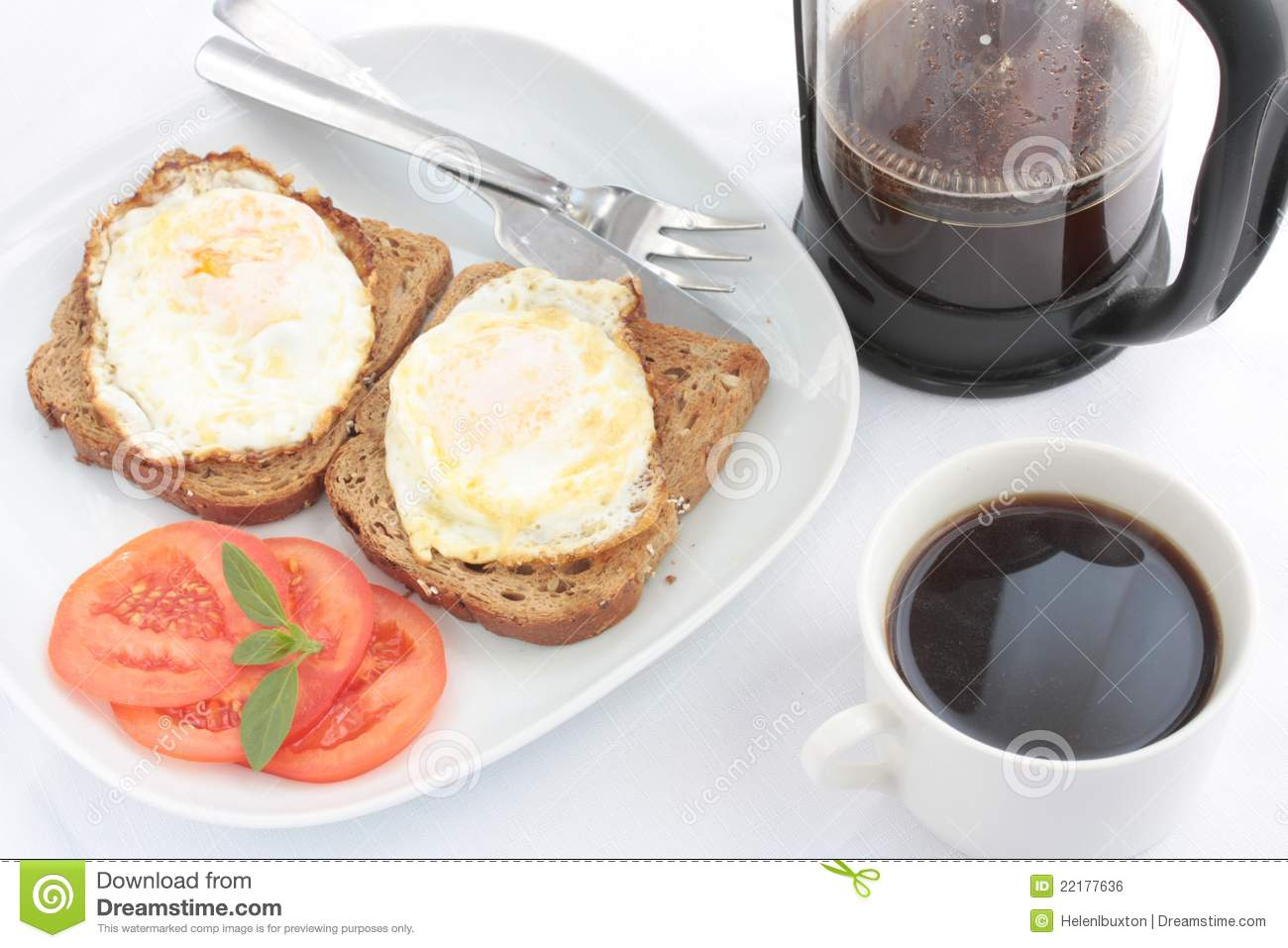 Breakfast of eggs on toast with coffee