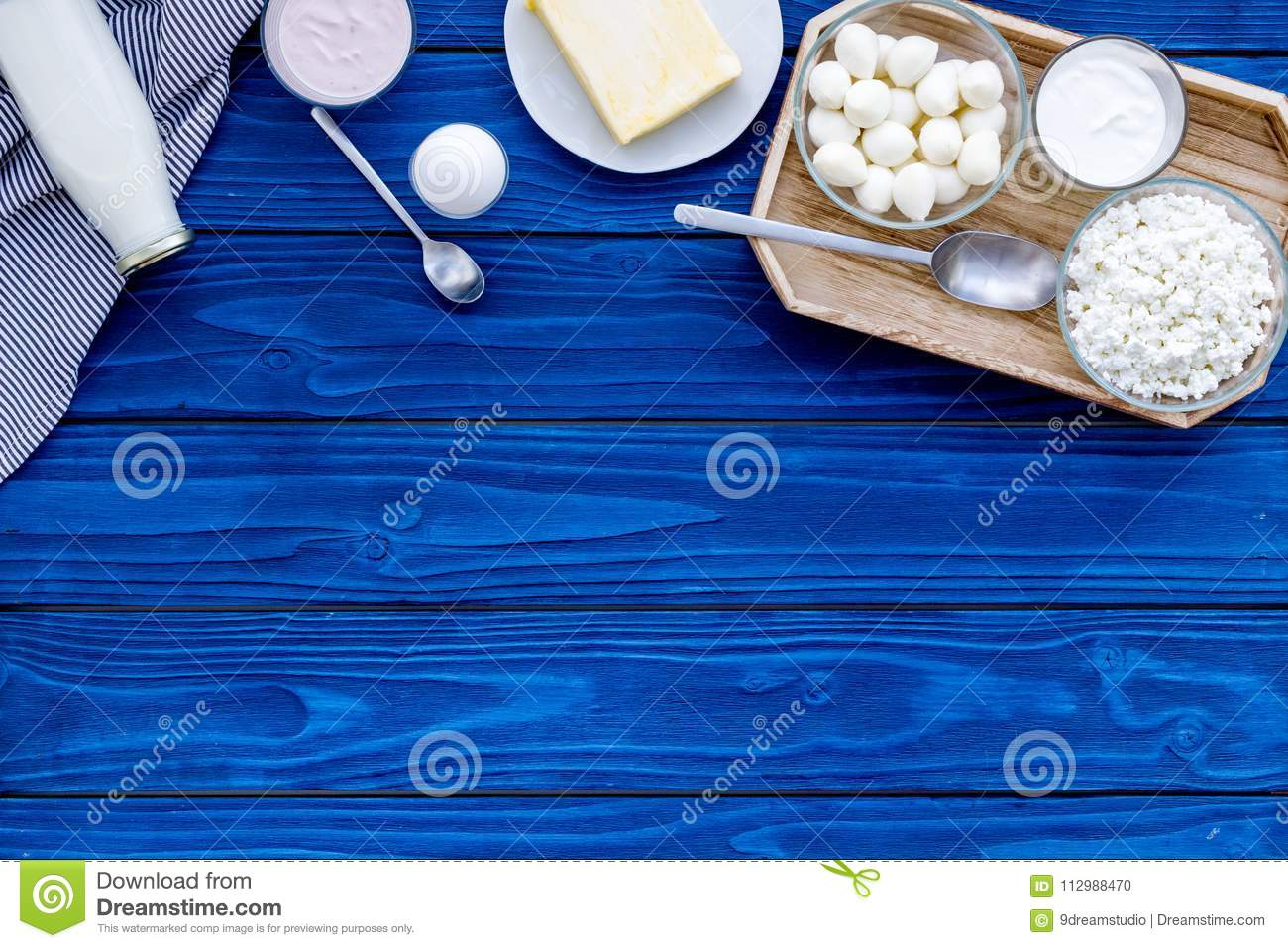 Breakfast on farm with dairy products. Milk, cottage, cheese, yougurt on blue table top view mock-up