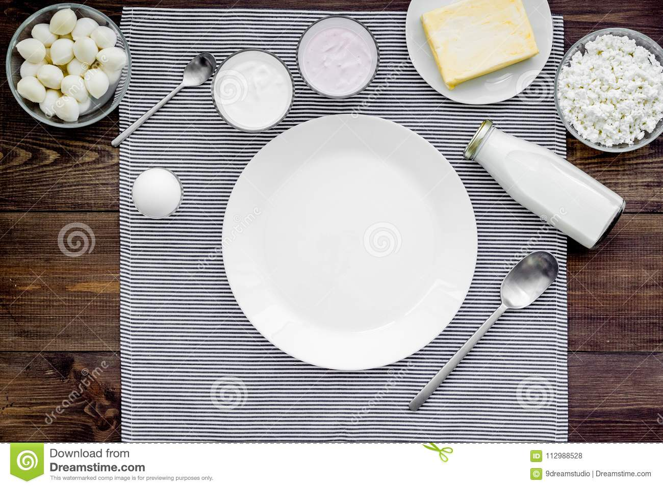 Breakfast on farm with dairy products. Milk, cottage, cheese, yougurt on wooden table top view mock-up