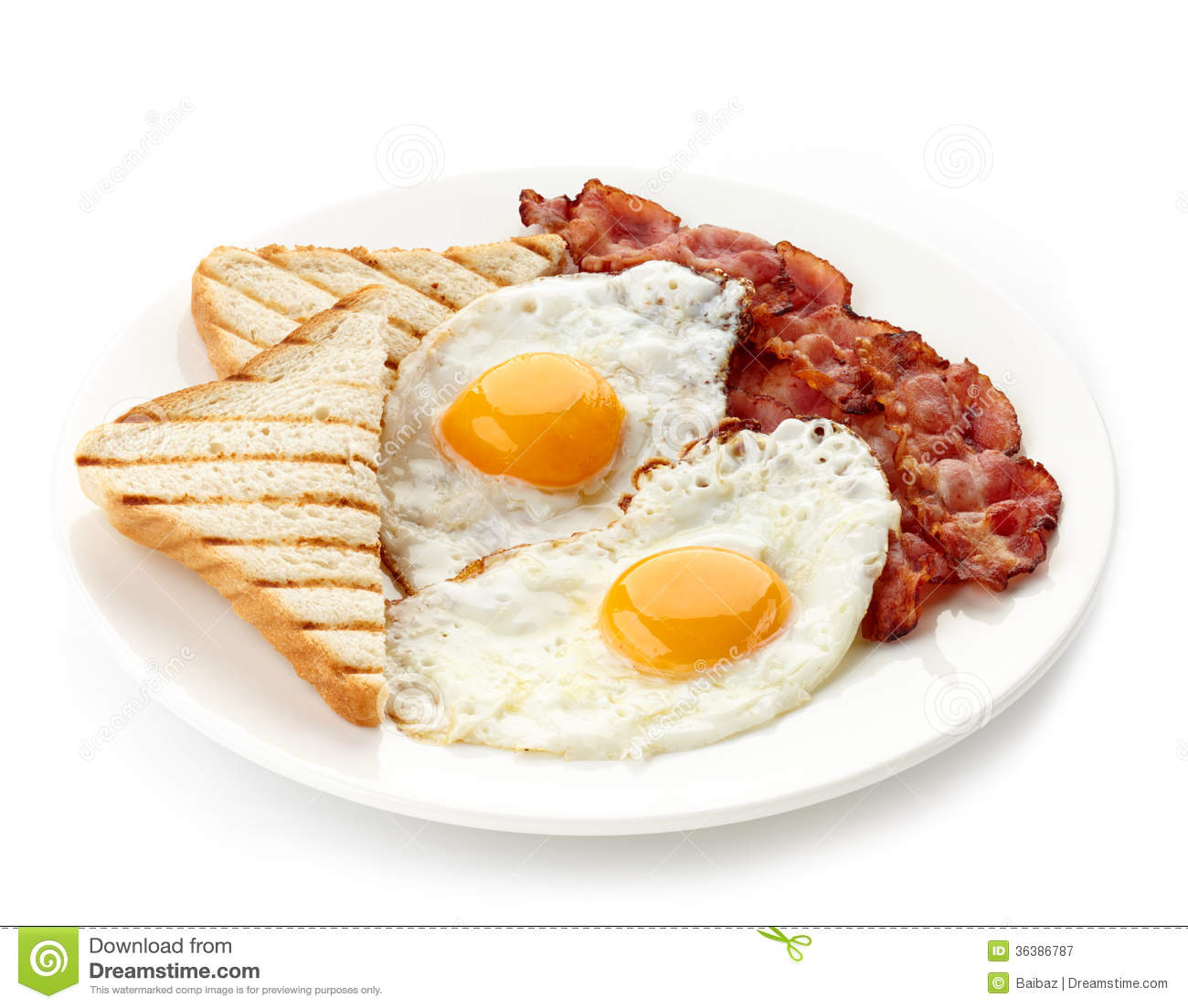 Plate of breakfast with fried eggs, bacon and toasts isolated on white ...