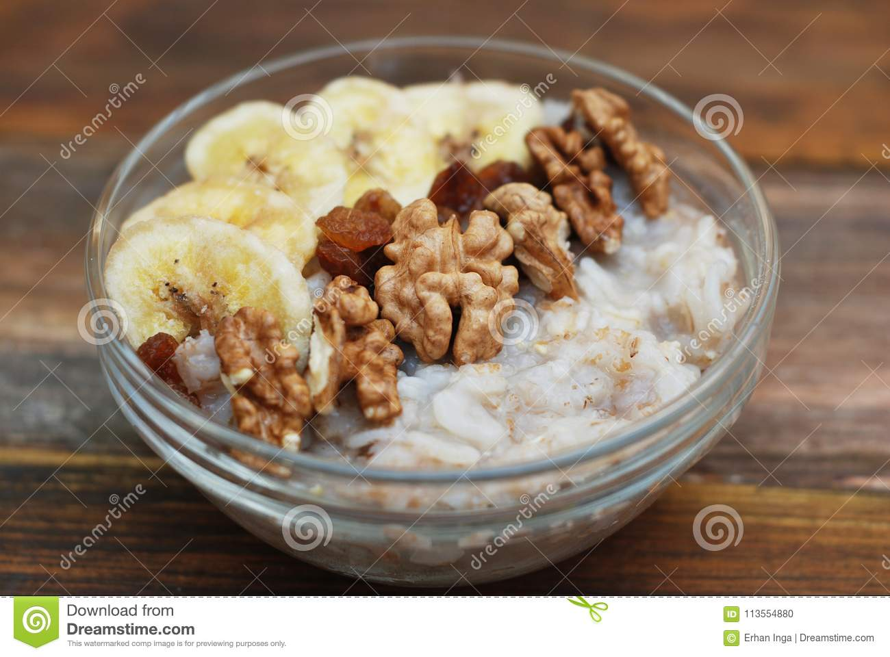 Breakfast with Granola Bowl, Muesli with Oats, Nuts and Dried Fruit, Milk, on Wooden table. Bannana, nuts, fruits. Healthy Breakfa