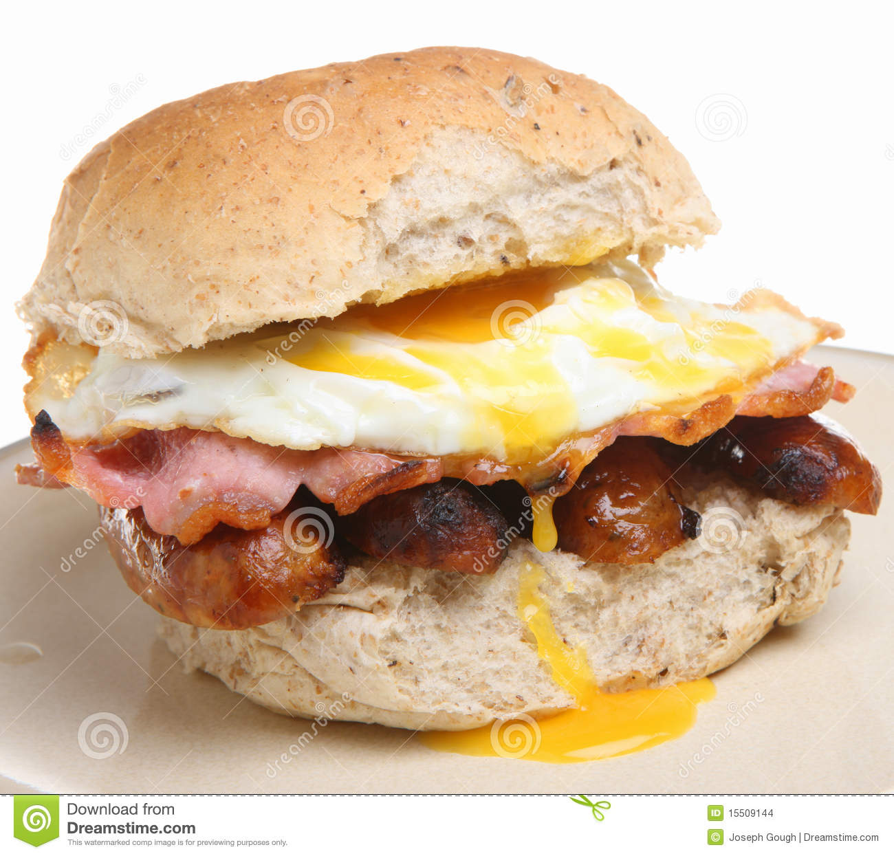 Breakfast Roll With Sausage, Bacon & Egg Stock Images - Image ...