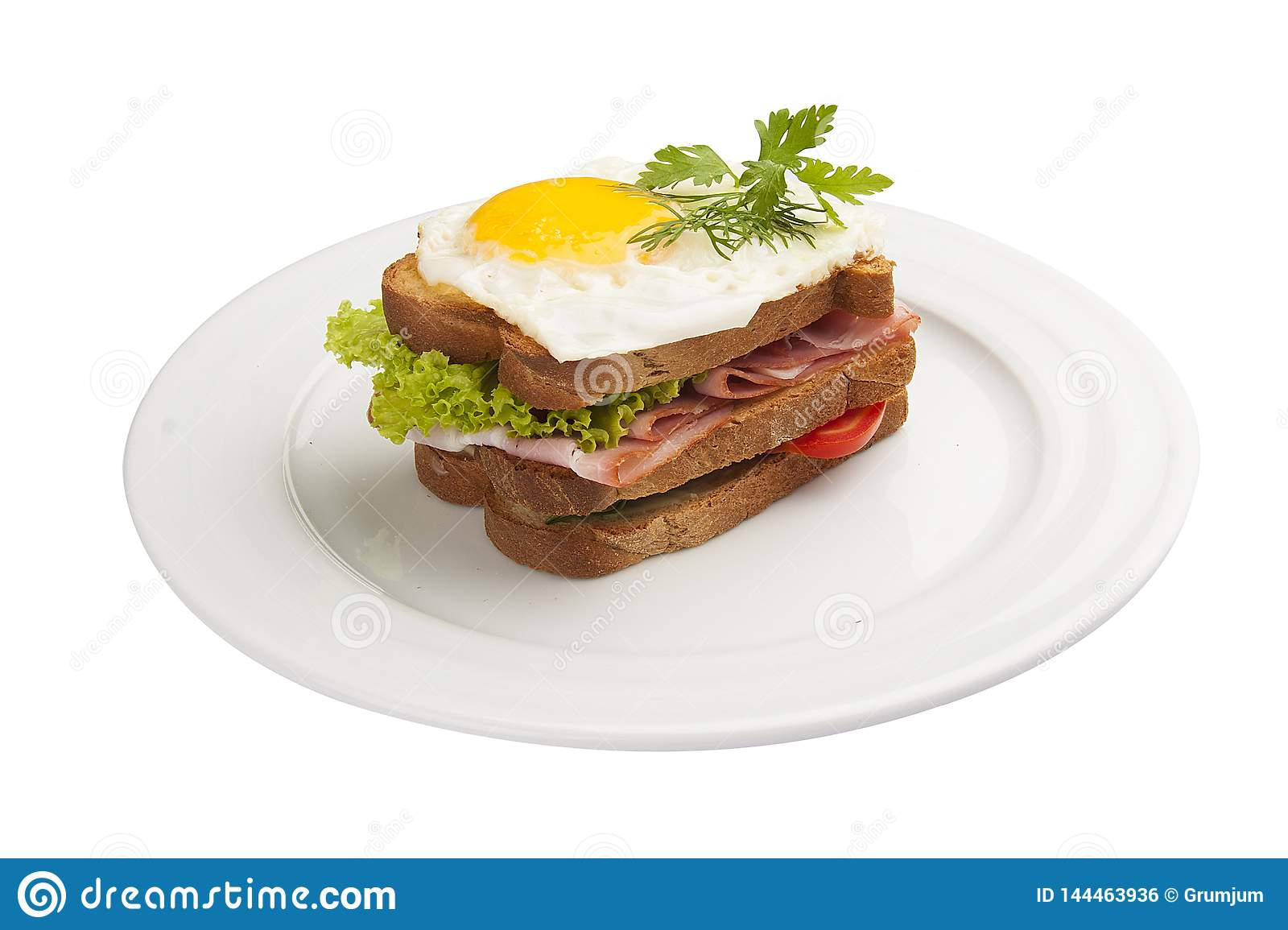 Breakfast. Sandwich with egg, ham and tomato.