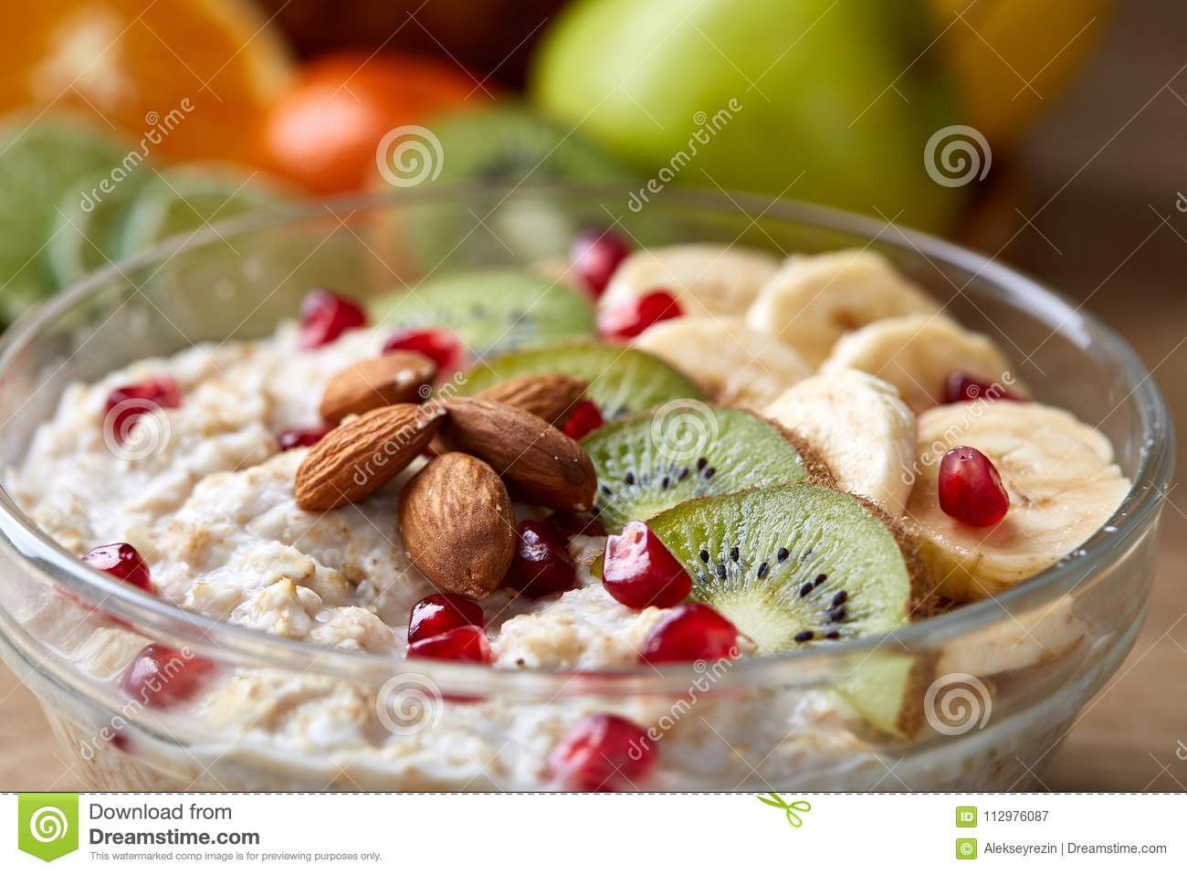 Breakfast still life with oatmeal porridge and fruits, top view, selective focus, shallow depth of field.
