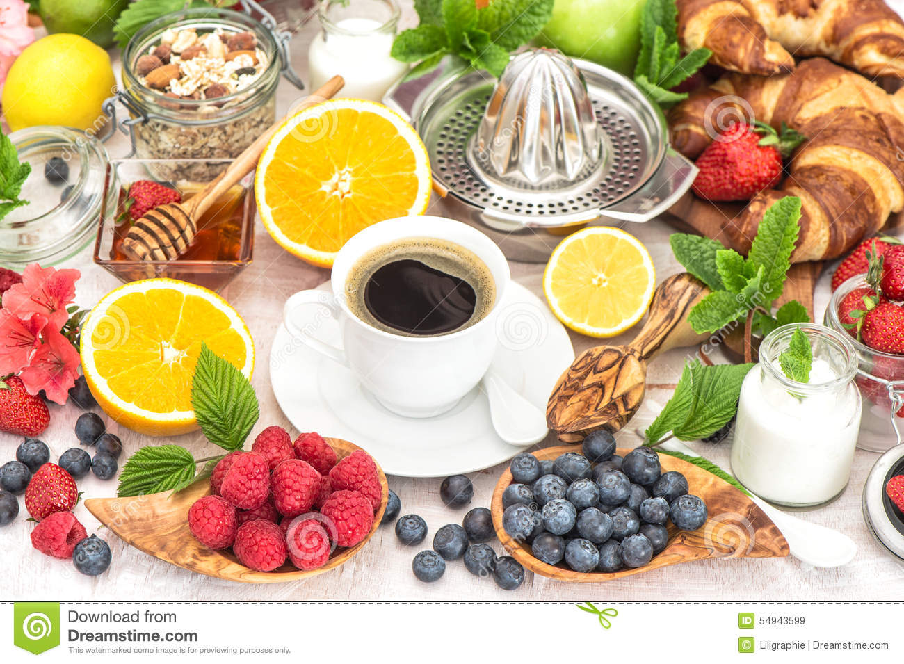 breakfast table setting with coffee croissants muesli honey stock photo image 54943599. Black Bedroom Furniture Sets. Home Design Ideas