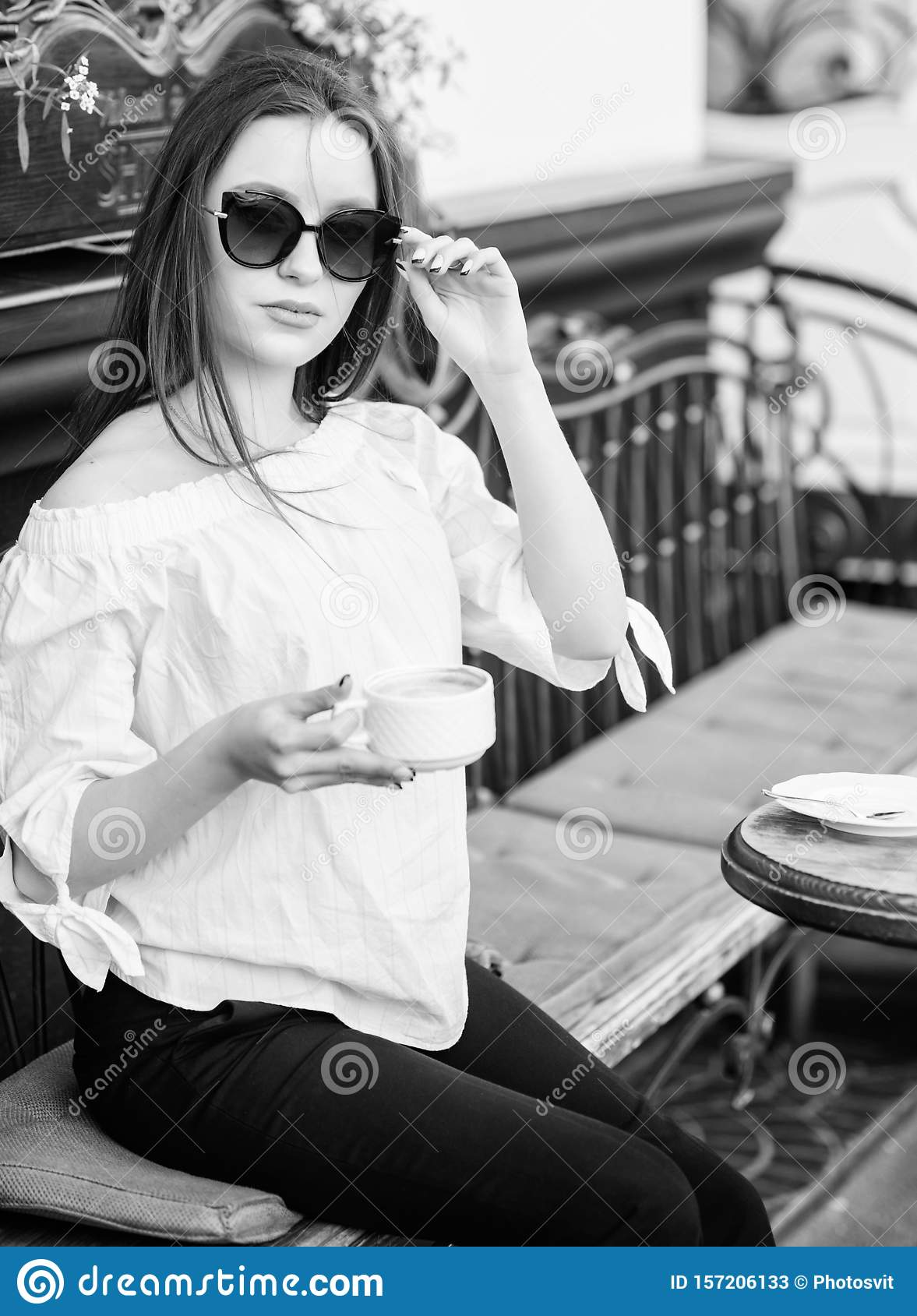 Breakfast time in cafe. Girl enjoy morning coffee. Woman in sunglasses drink coffee outdoors. Girl relax in cafe