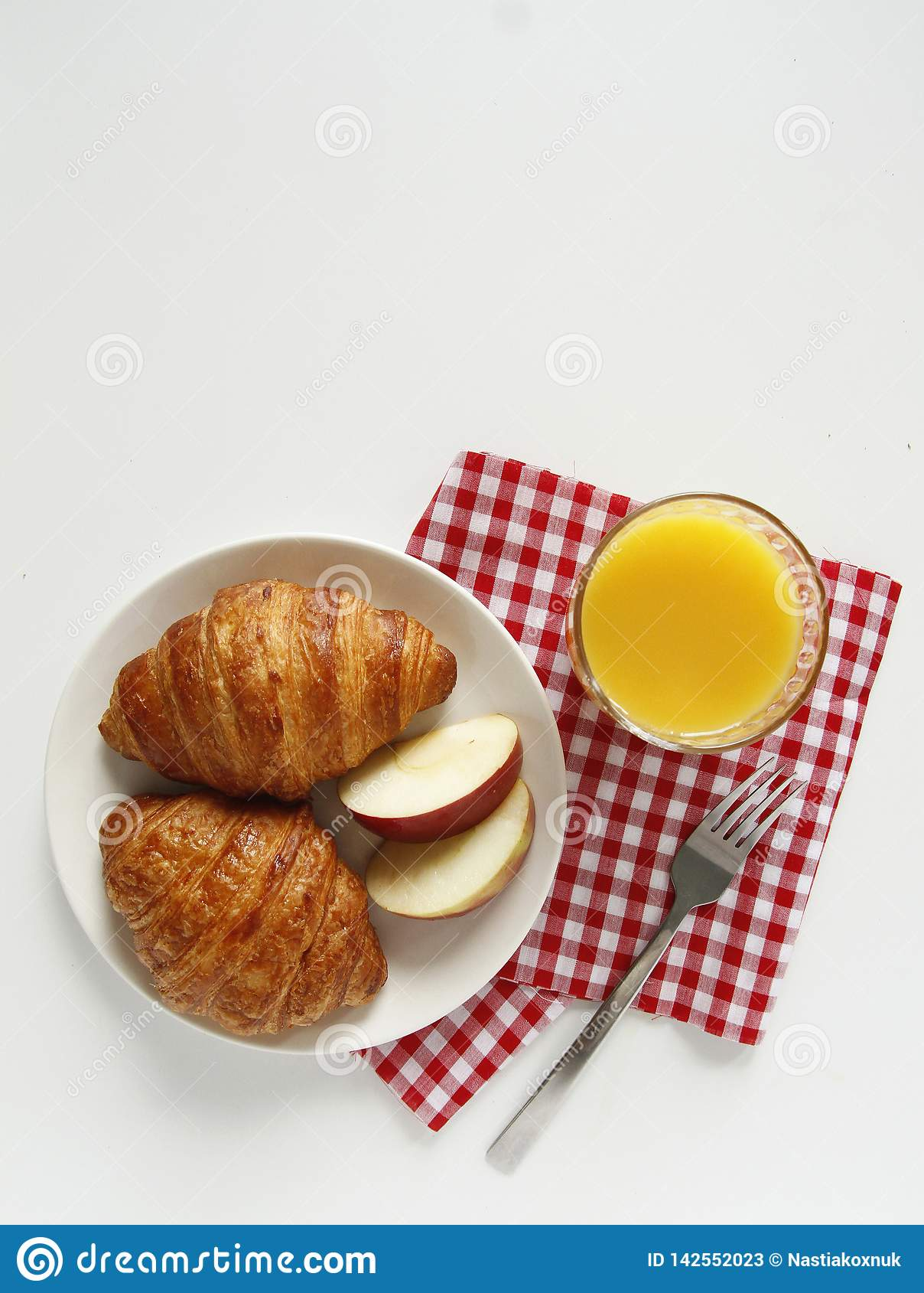 Breakfast. top view. croissant, orange juice