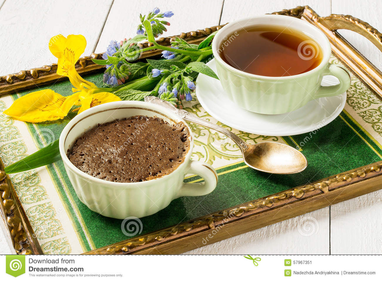 Breakfast on a tray a chocolate cupcake and a cup of tea stock breakfast on a tray a chocolate cupcake and a cup of tea izmirmasajfo
