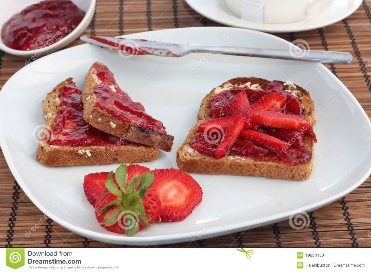 Breakfast of wholemeal toast with strawberry jelly