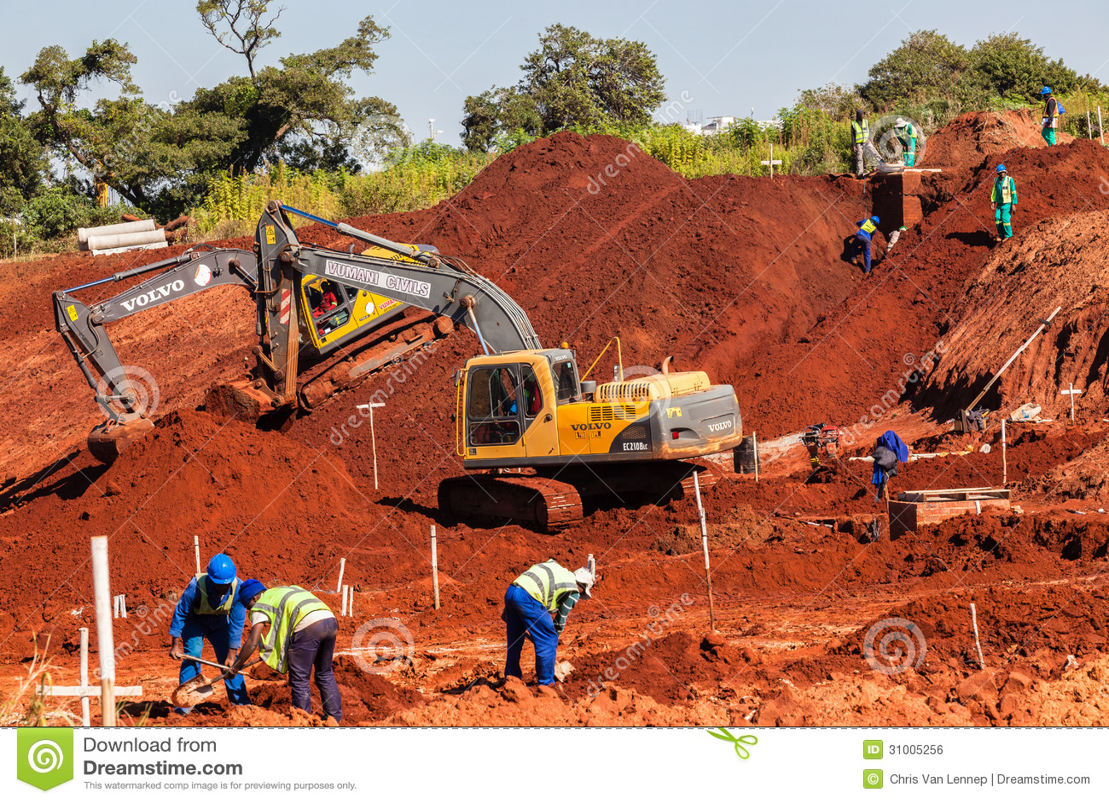 Earthwork Construction Management : Breaking ground excavators construction editorial photo