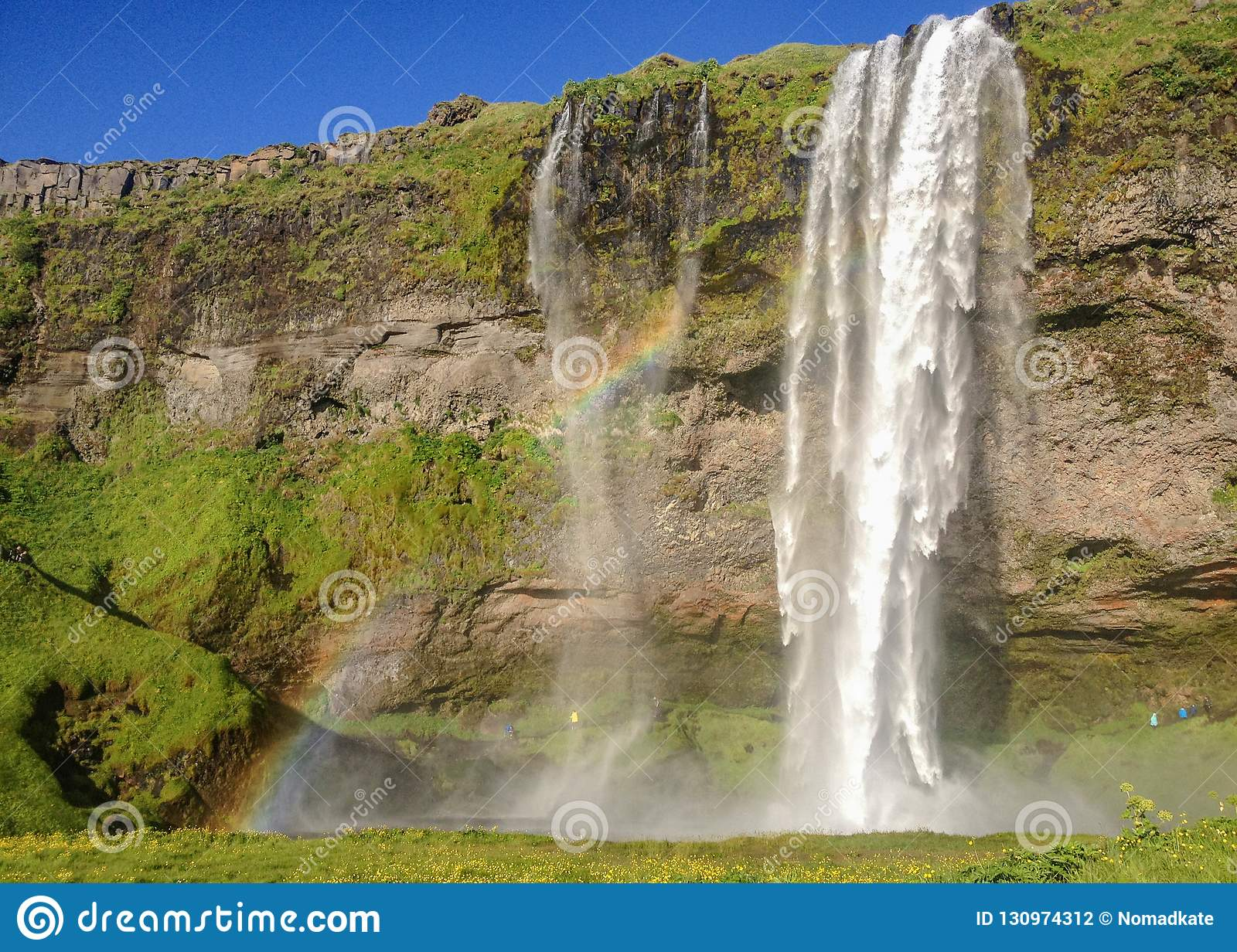 Breathtakingly beautiful waterfall Seljalandsfoss in sunny summer day with rainbow. South Iceland, Europe