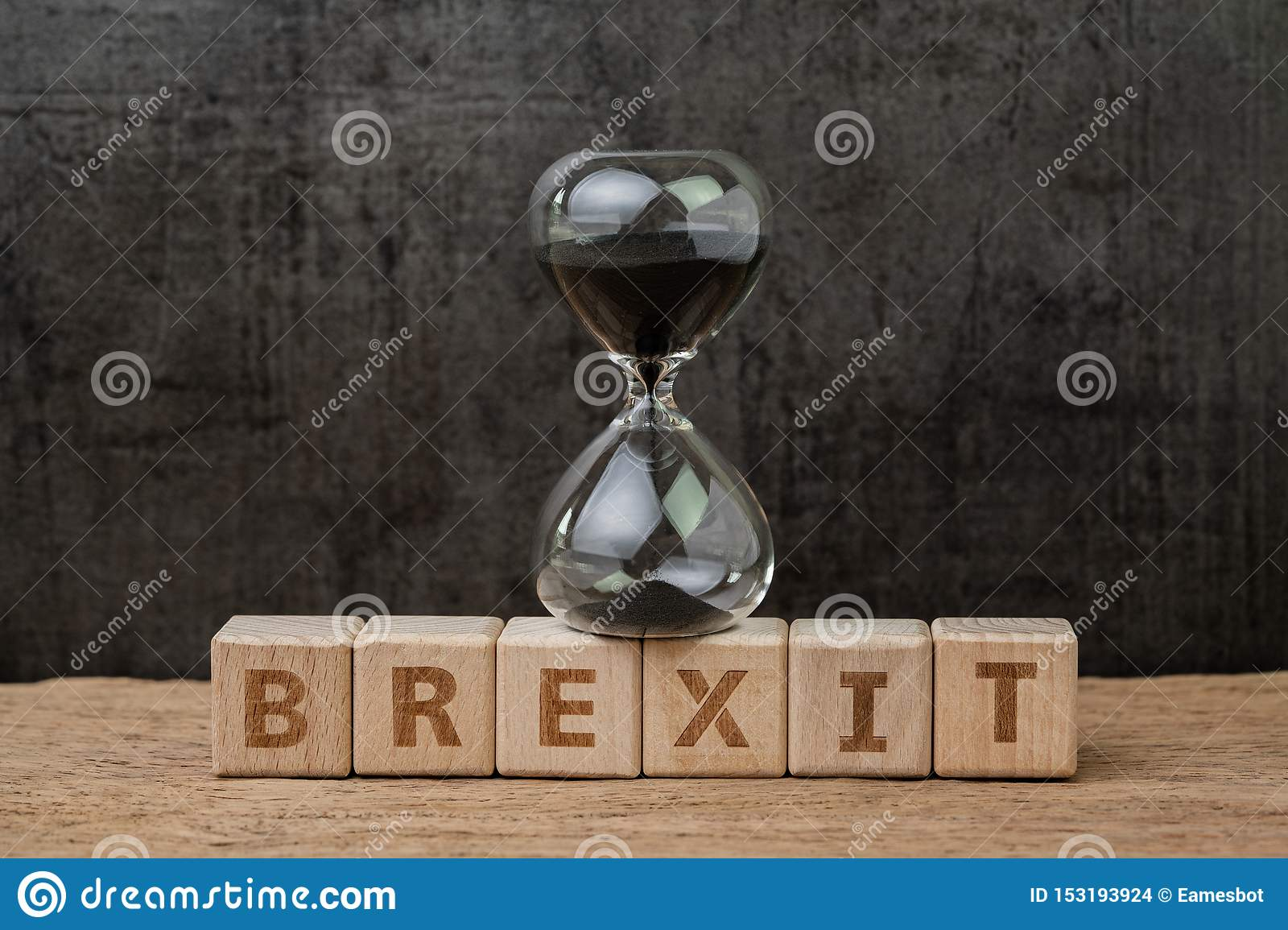 Brexit, time countdown for the UK to deal and withdraw from Euro zone concept, sandglass or hourglass on wooden cube block with