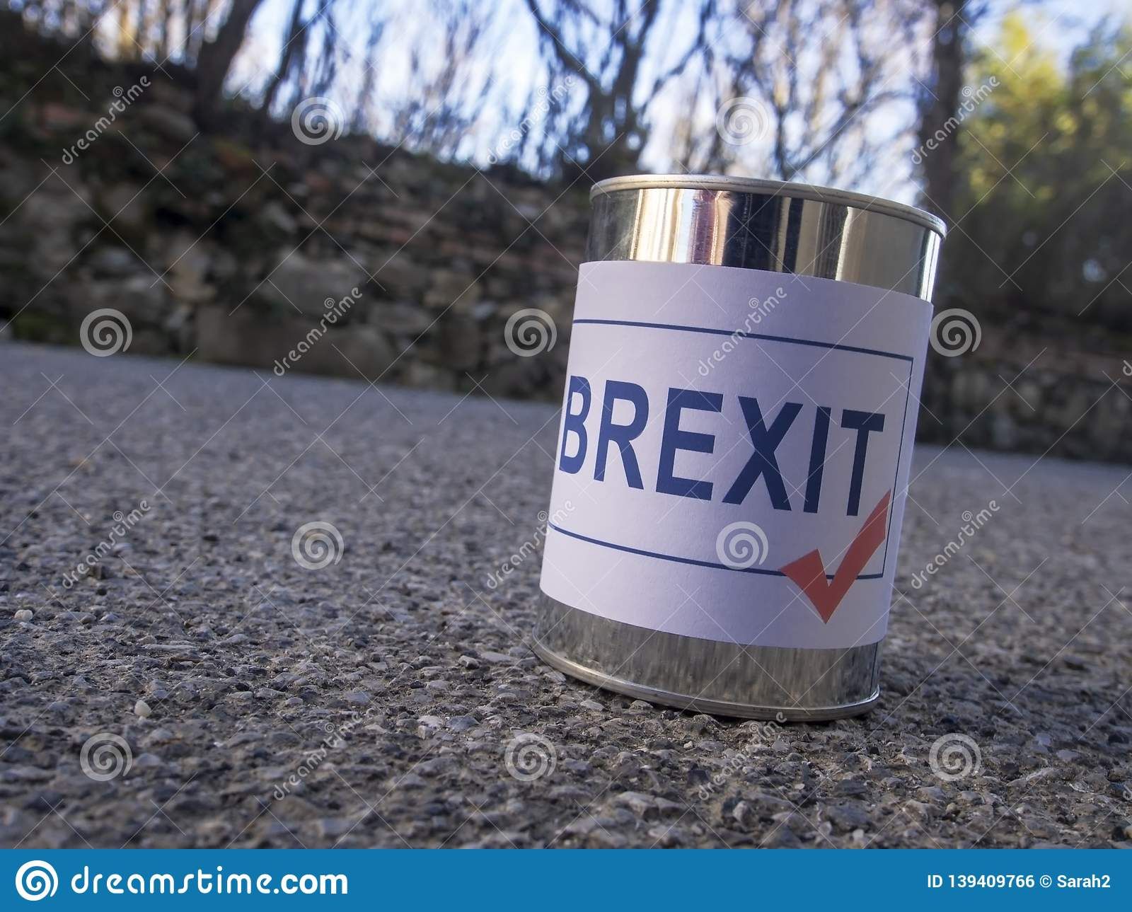 Brexit tin can in the road ready for a kick, UK EU politics metaphor or concept.