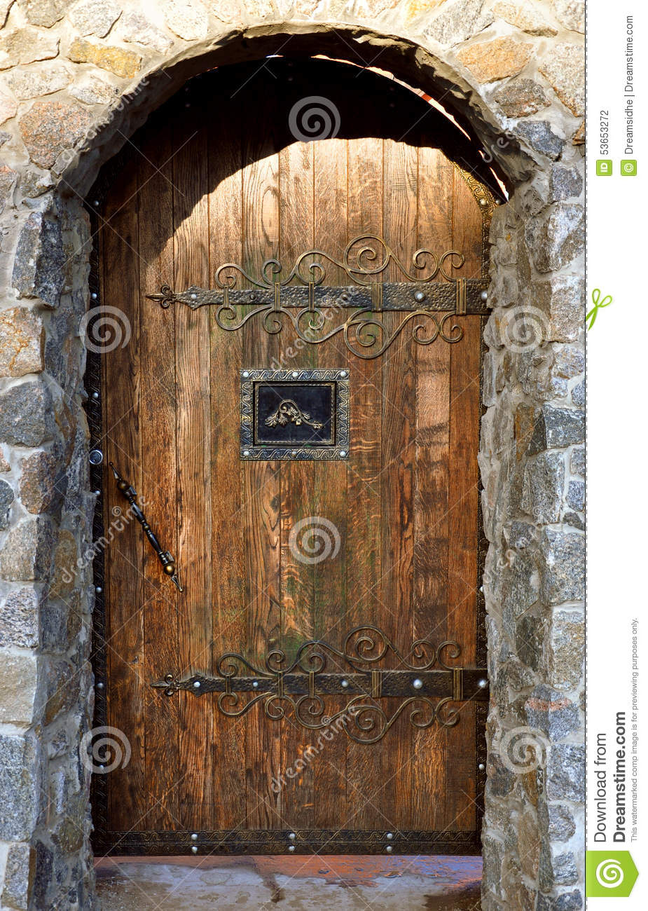 Brick Arch With Wooden Doors Stock Photo