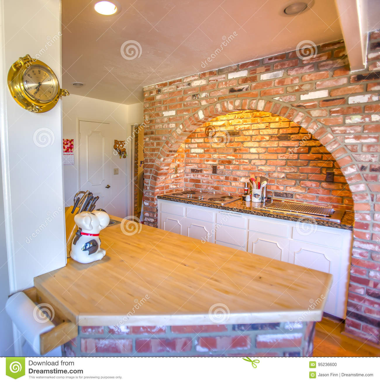 - Brick Backsplash And Arch With Stove In Ranch Style Home In