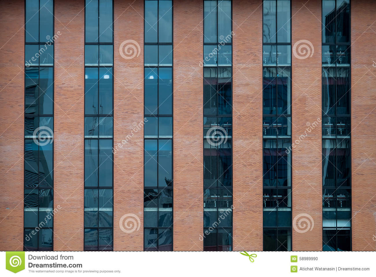 Brick Building Facade With A Blue Glass For Texture Stock