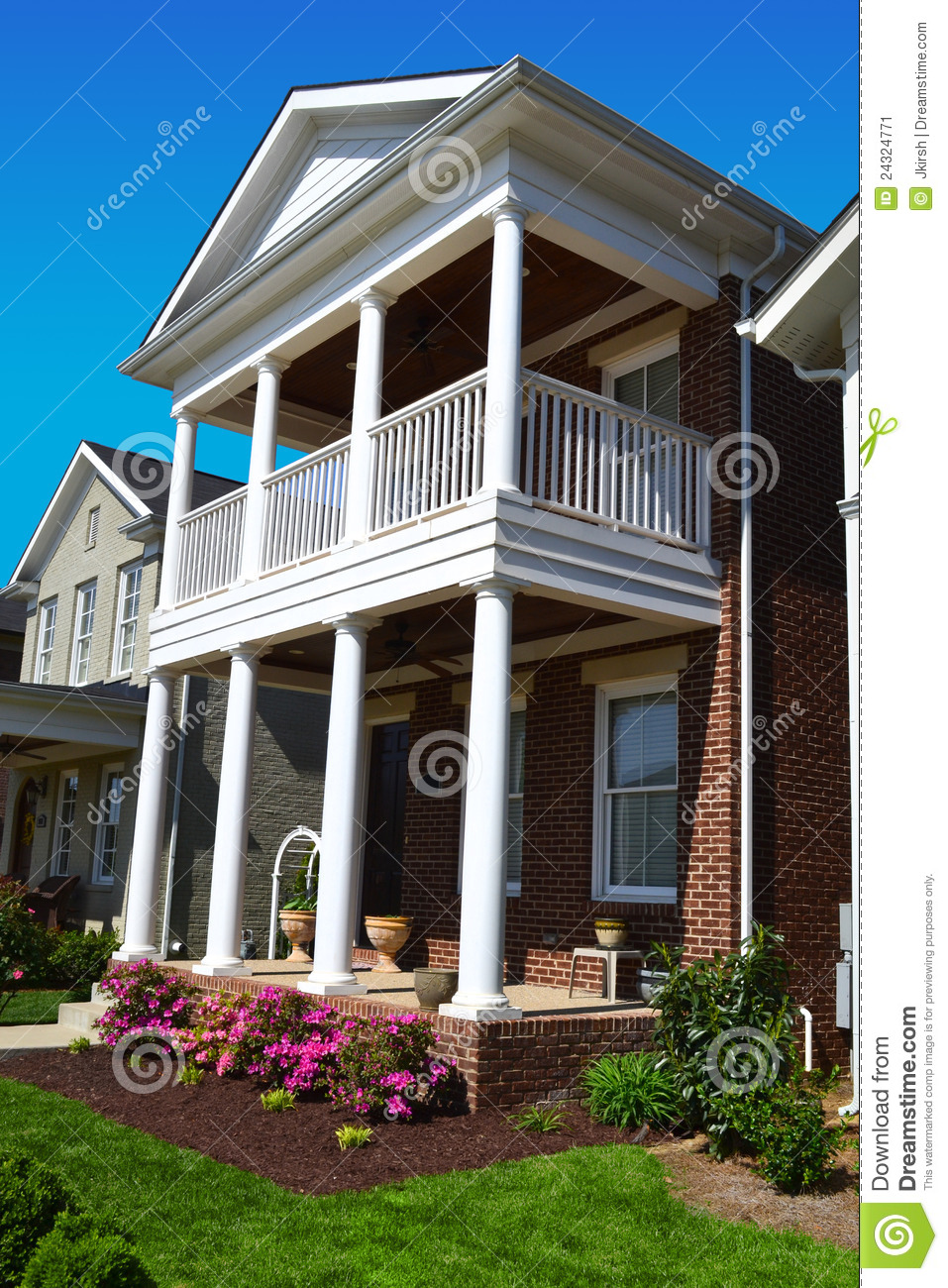 Brick cape cod style home with porch stock image image for Cape cod homes with front porches