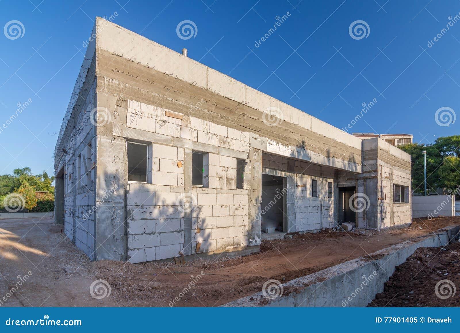 Concrete house under construction the for Brick house construction