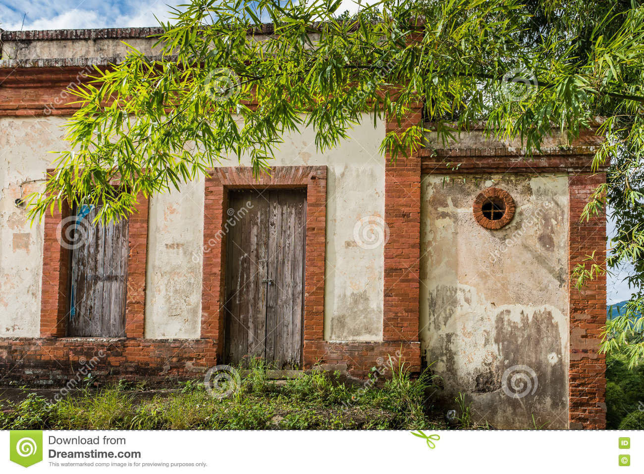 Brick and concrete structure along the road with old wooden door