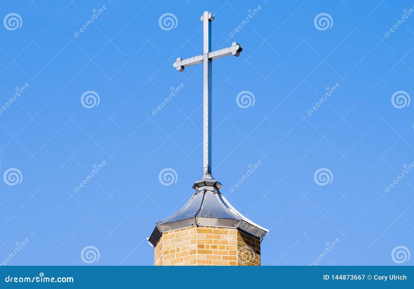 Brick Cross on Blue Sky