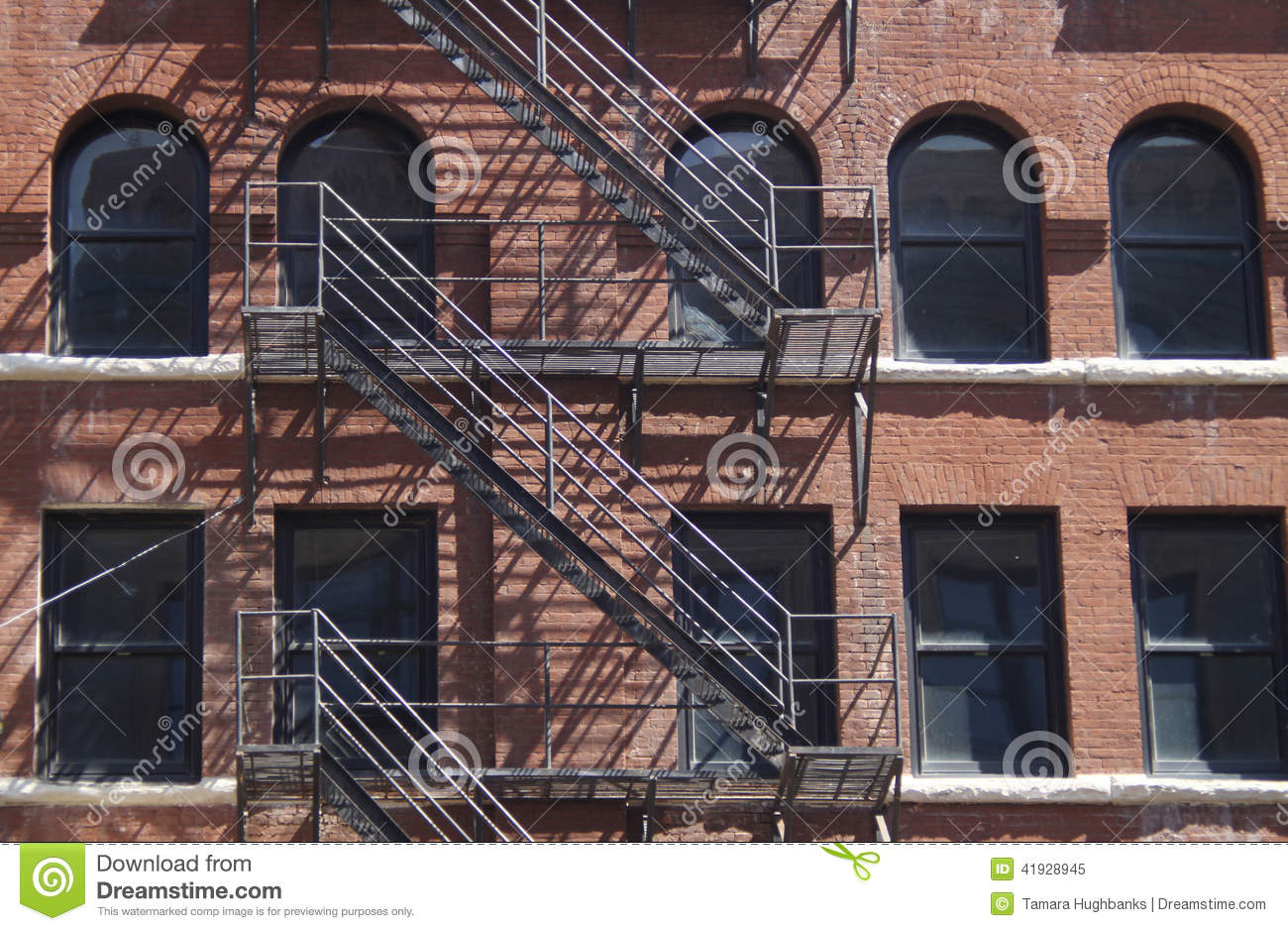 Brick historic building with fire escapes
