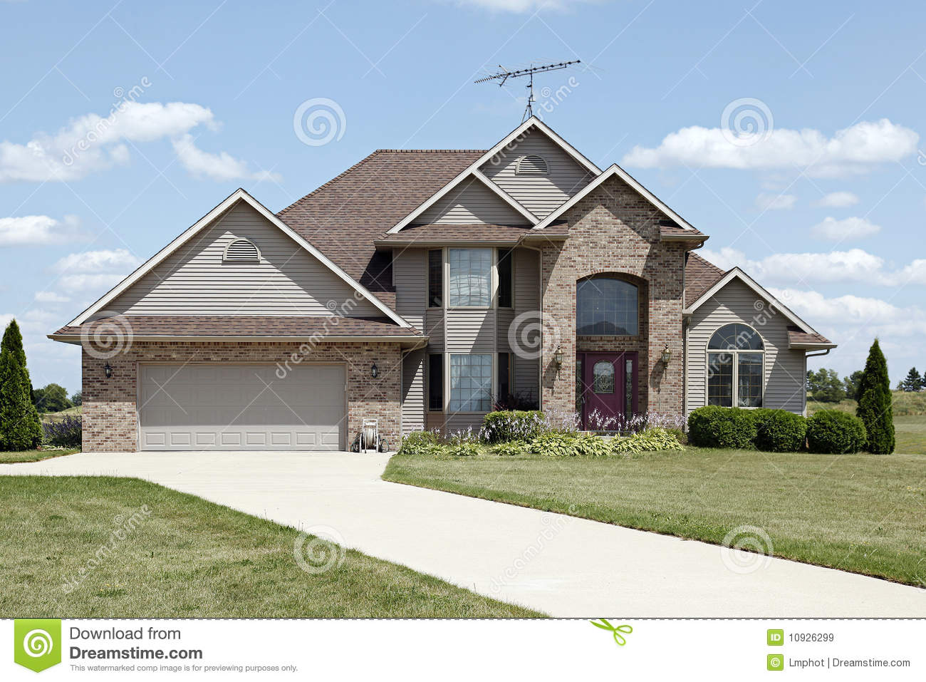 Brick Home With Arched Entryway Royalty Free Stock Images - Image