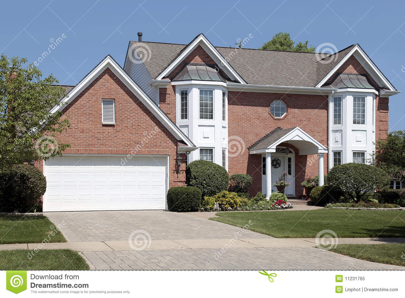 Brick Home With Columns In Entryway Royalty Free Stock Photo