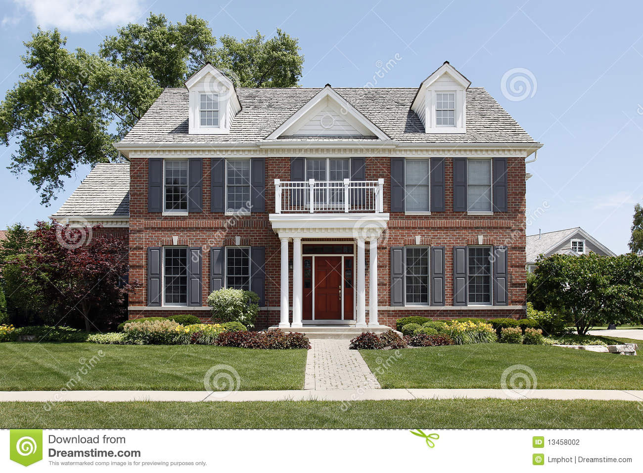 Brick home with front balcony stock photo image 13458002 for Front balcony