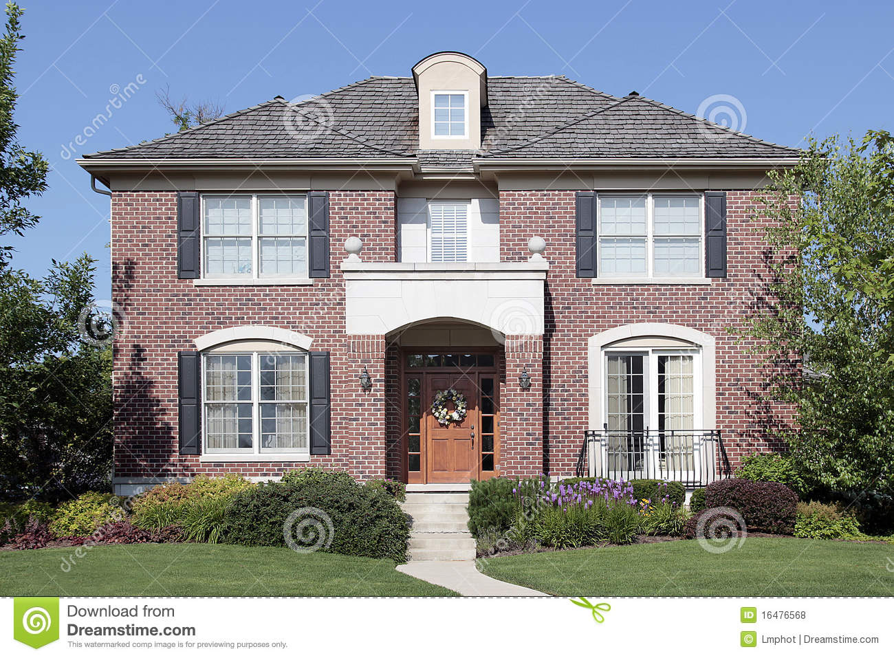 brick home with front balcony royalty free stock photos