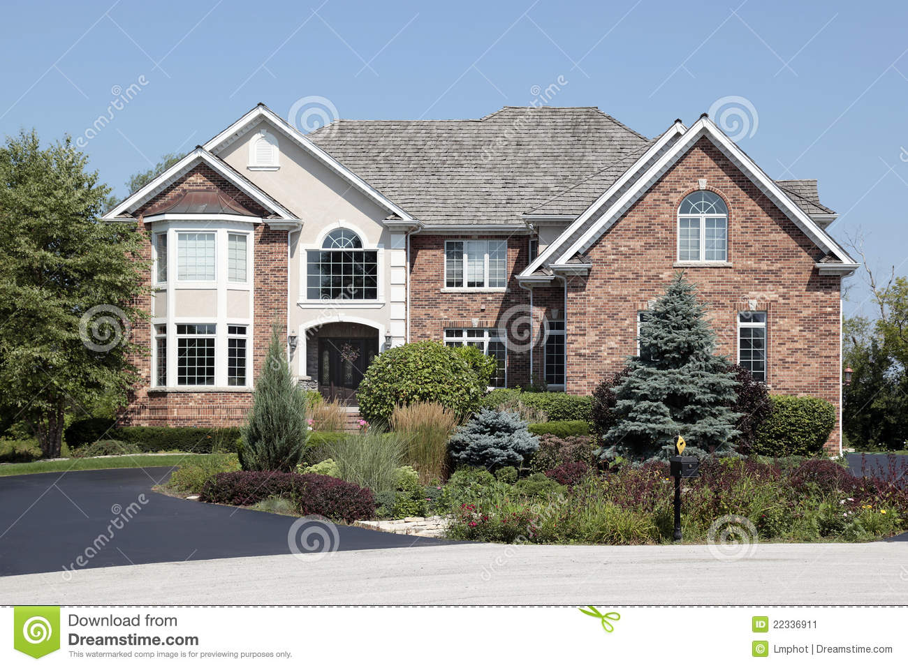 Landscaping Front Of Brick House : Brick home with front landscaping stock image
