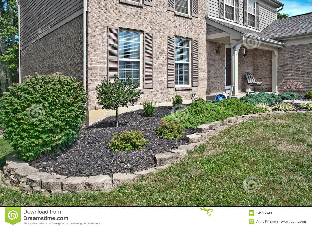 Landscaping Bricks : Brick home landscaping beds stock photos image