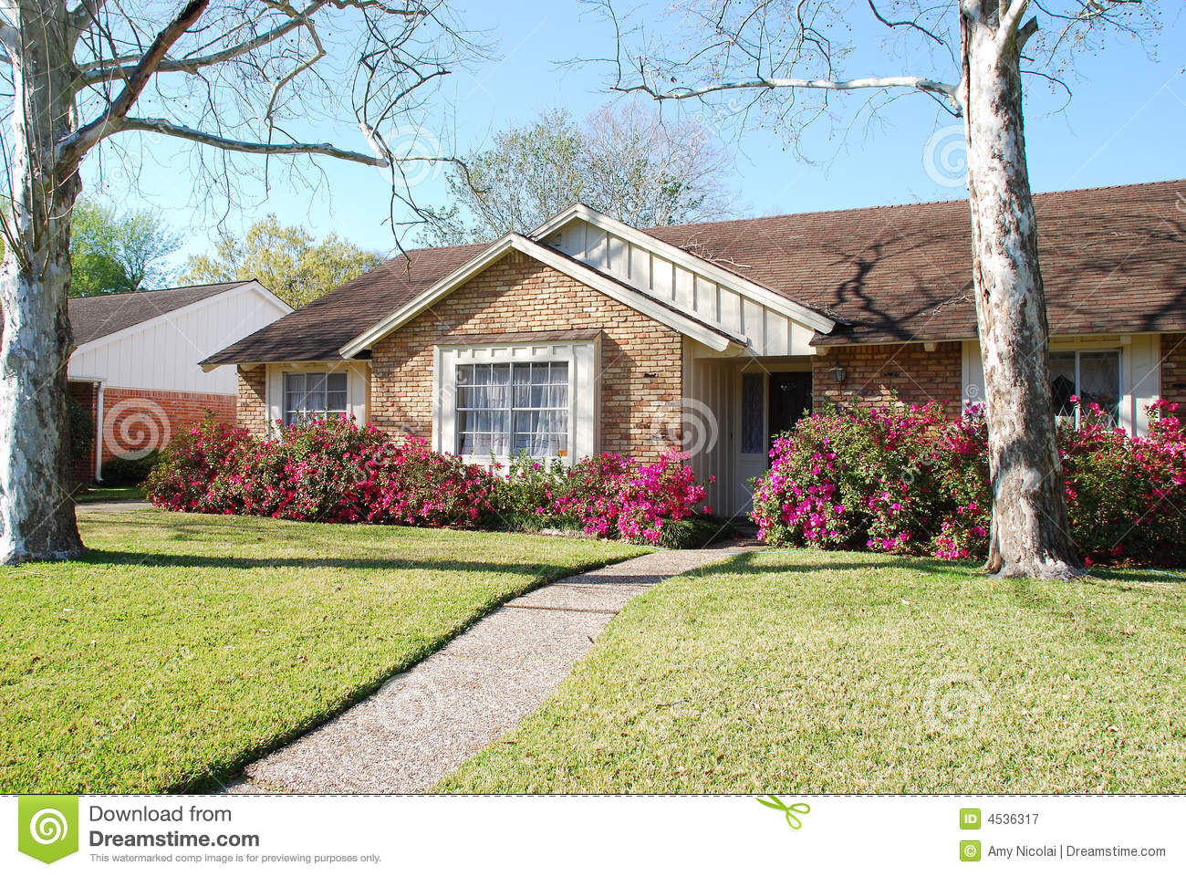 Brick home with pink azaleas