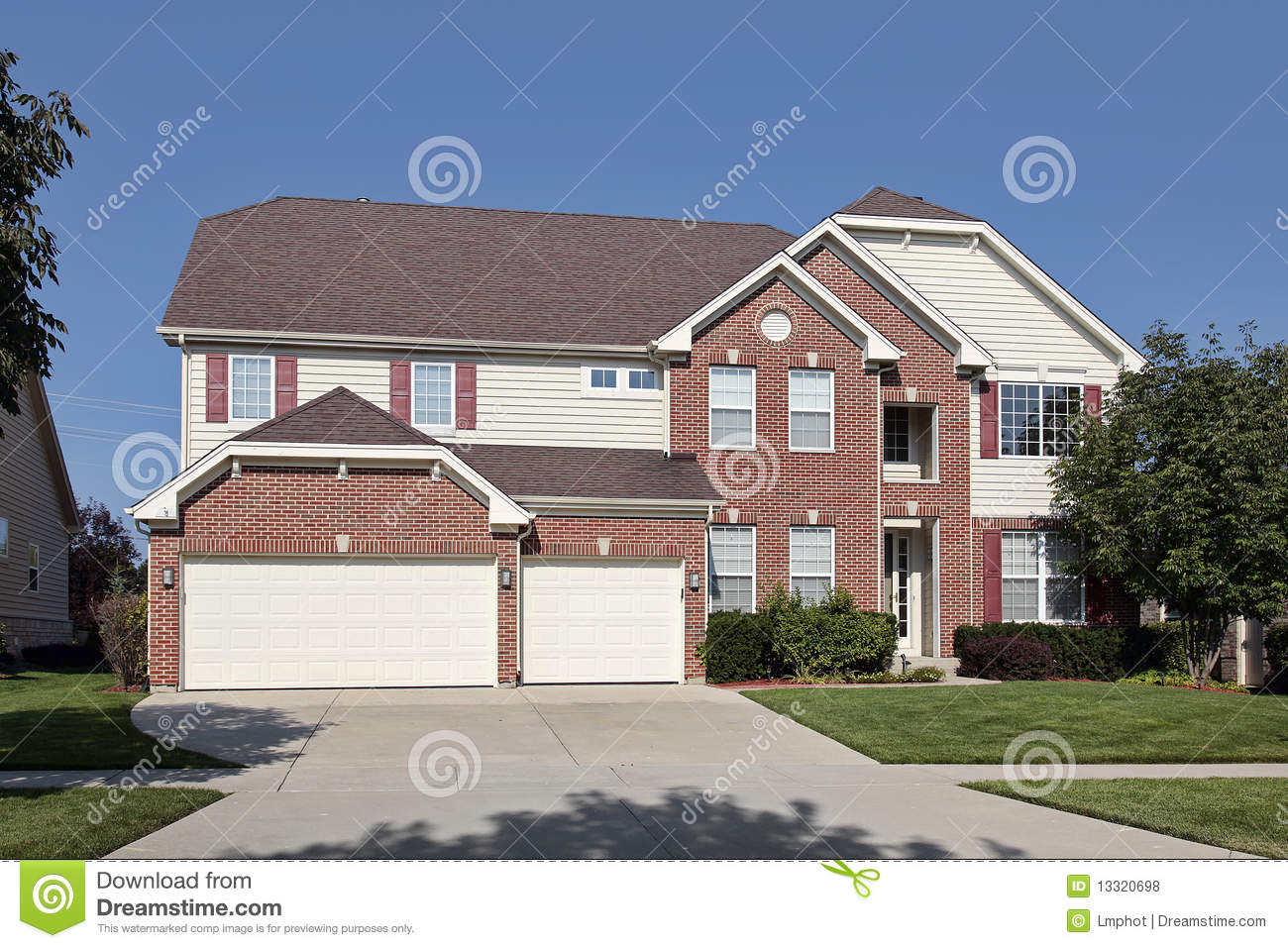 Brick home with three car garage royalty free stock photos for 3 car garage homes