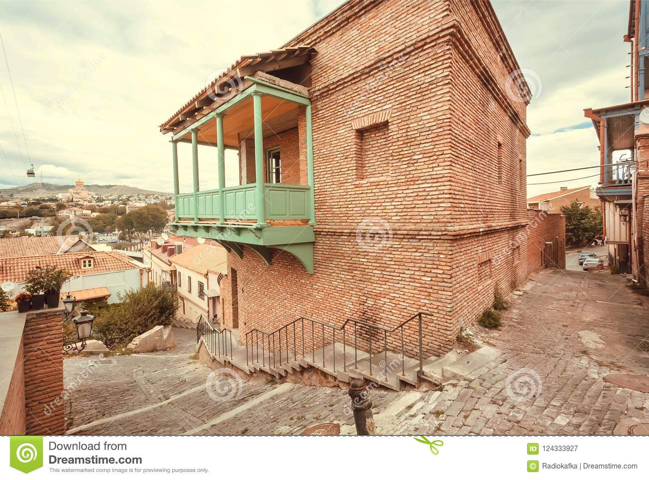 Brick house with balcony, facade in traditional style built in historical area of Tbilisi, Georgia country