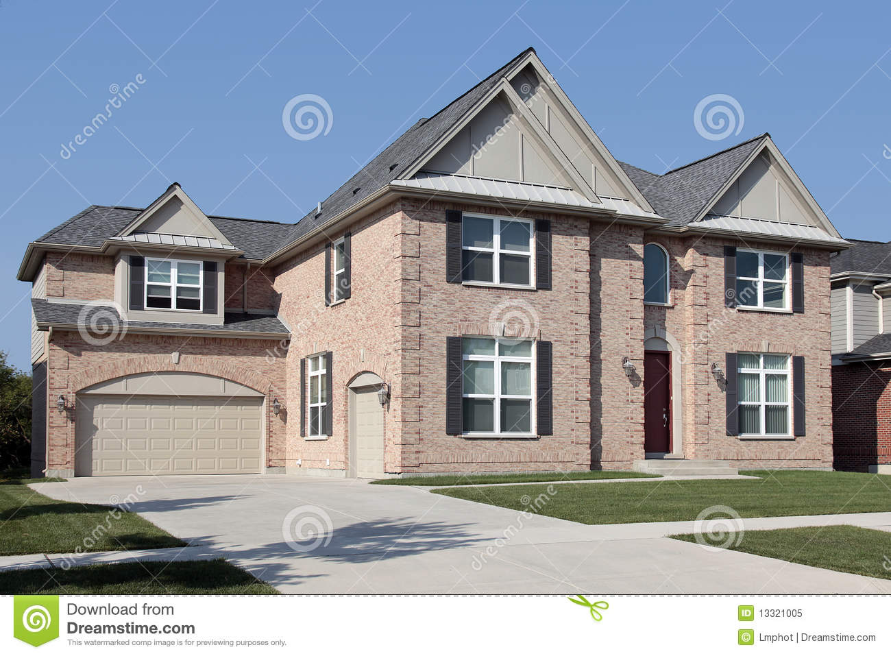 Brick house with black shutters royalty free stock photo Black brick homes