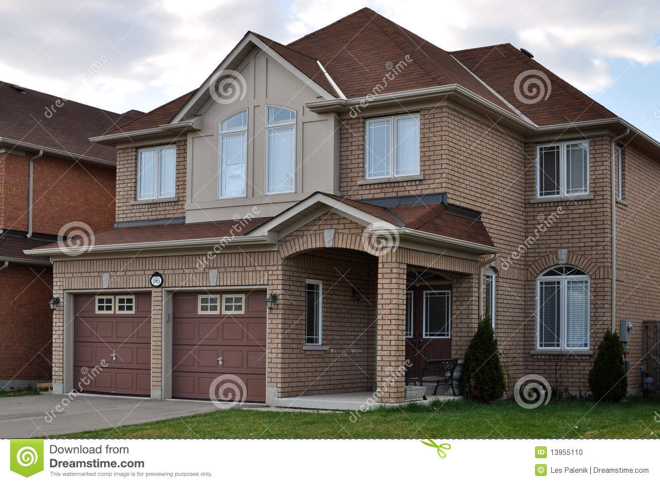 Brick house with a double garage stock photo image 13955110 for Double story garage