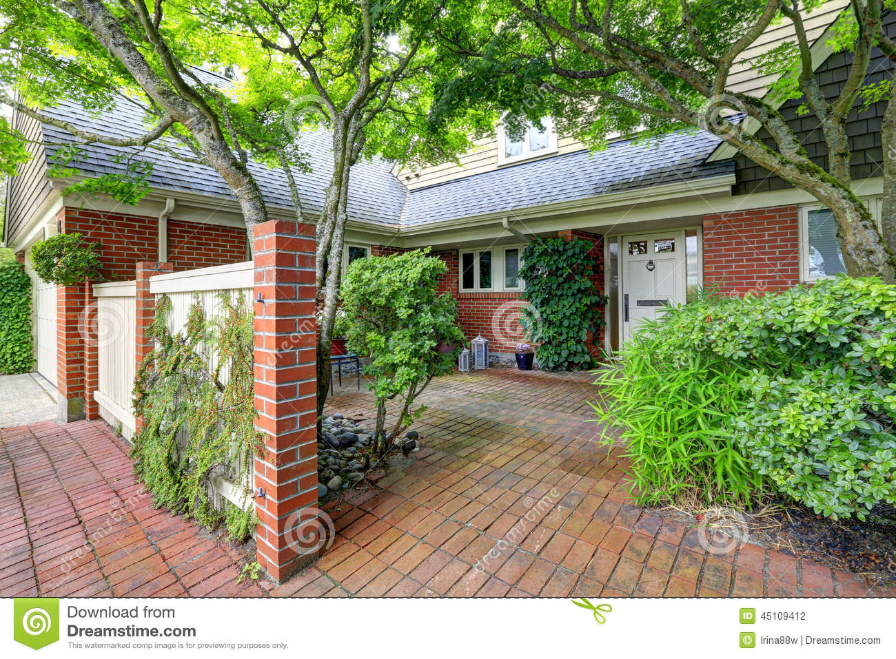 Brick House Exterior With Tile Floor Front Yard Stock