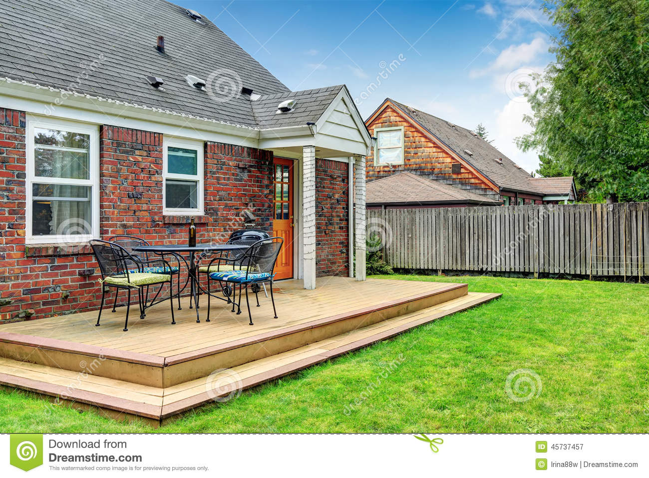 Brick House Exterior With Walkout Wooden Deck Stock Photo ... on House Backyard Deck id=94392