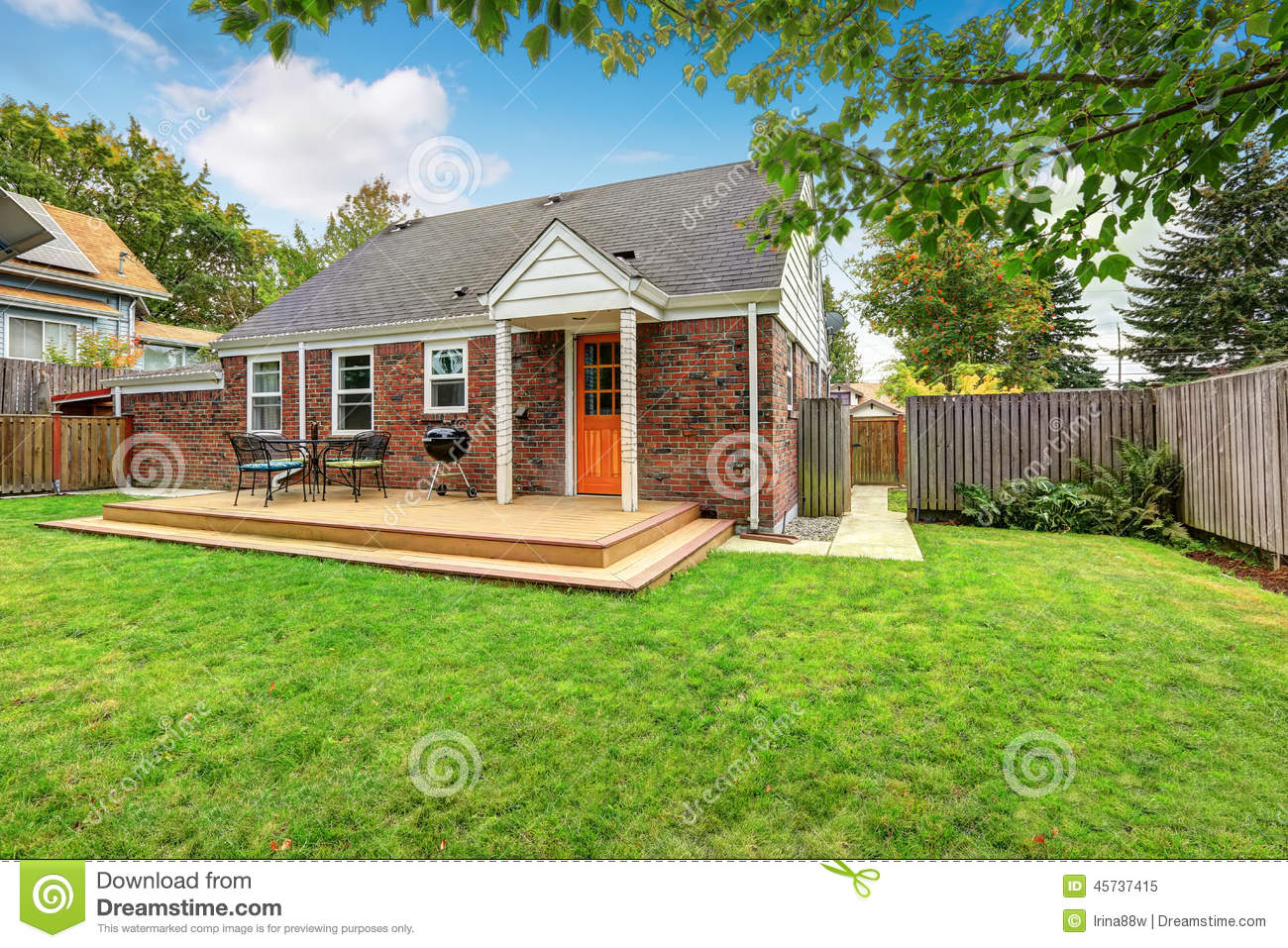 Brick House Exterior With Walkout Wooden Deck Stock Image ...
