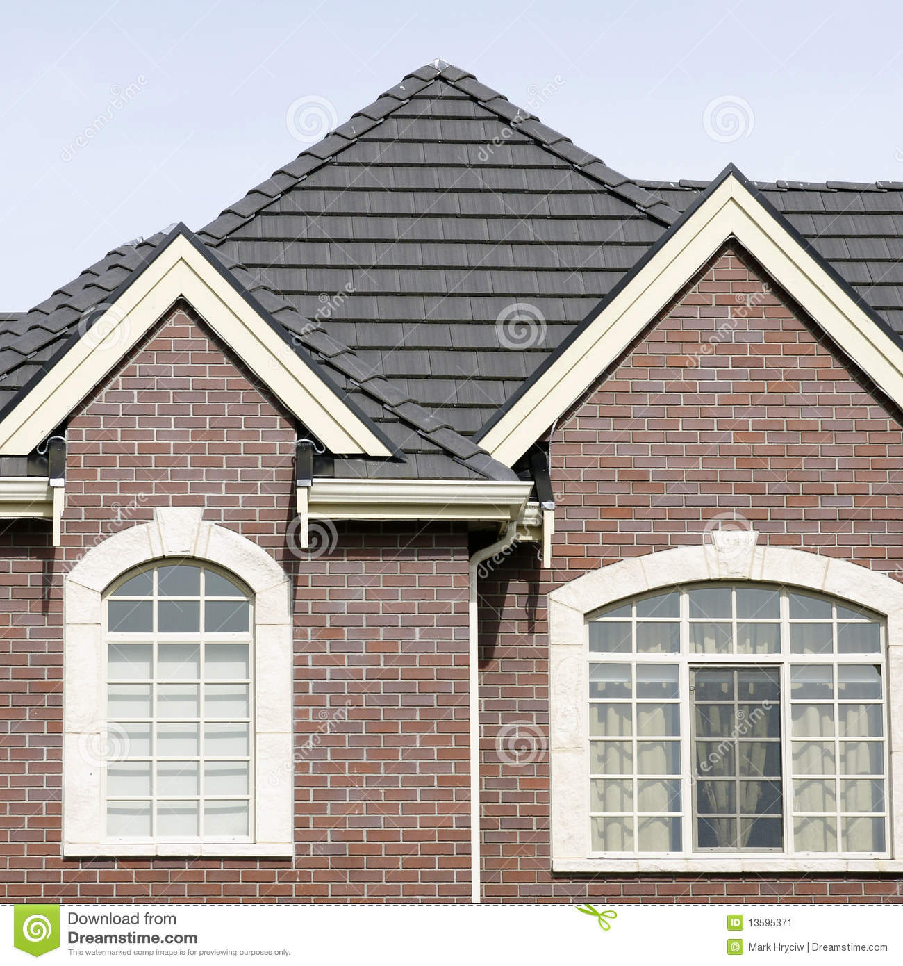 Brick house home exterior tile roof stock image image for Cupola on house